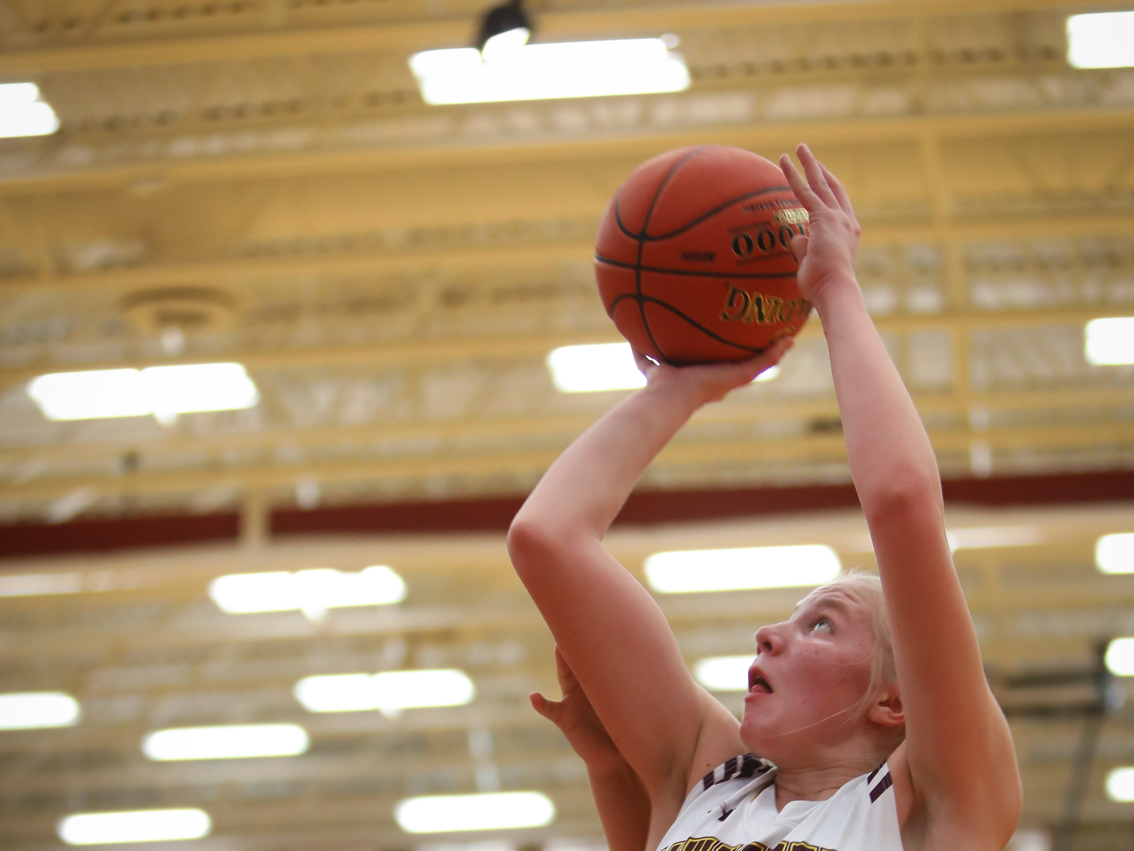 Ankeny sophomore Abby Johnson goes for a lay-up during a girls high school basketball game between the Lincoln Railsplitters and the Ankeny Hawks at Ankeny High School on Dec. 4, 2018 in Ankeny, Iowa.