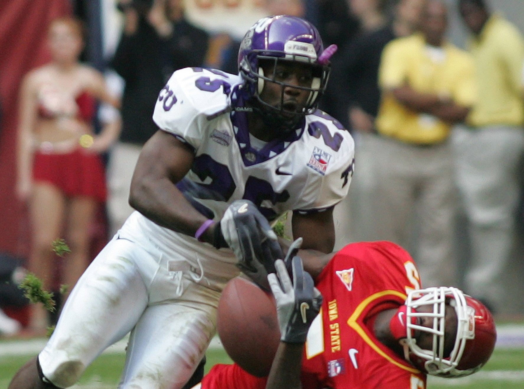 TCU's Eric Buchanan knocks the ball out of Iowa State receiver R.J. Sumrall's hands during the No. 14 Horned Frogs' 27-24 Houston Bowl victory in 2005.
