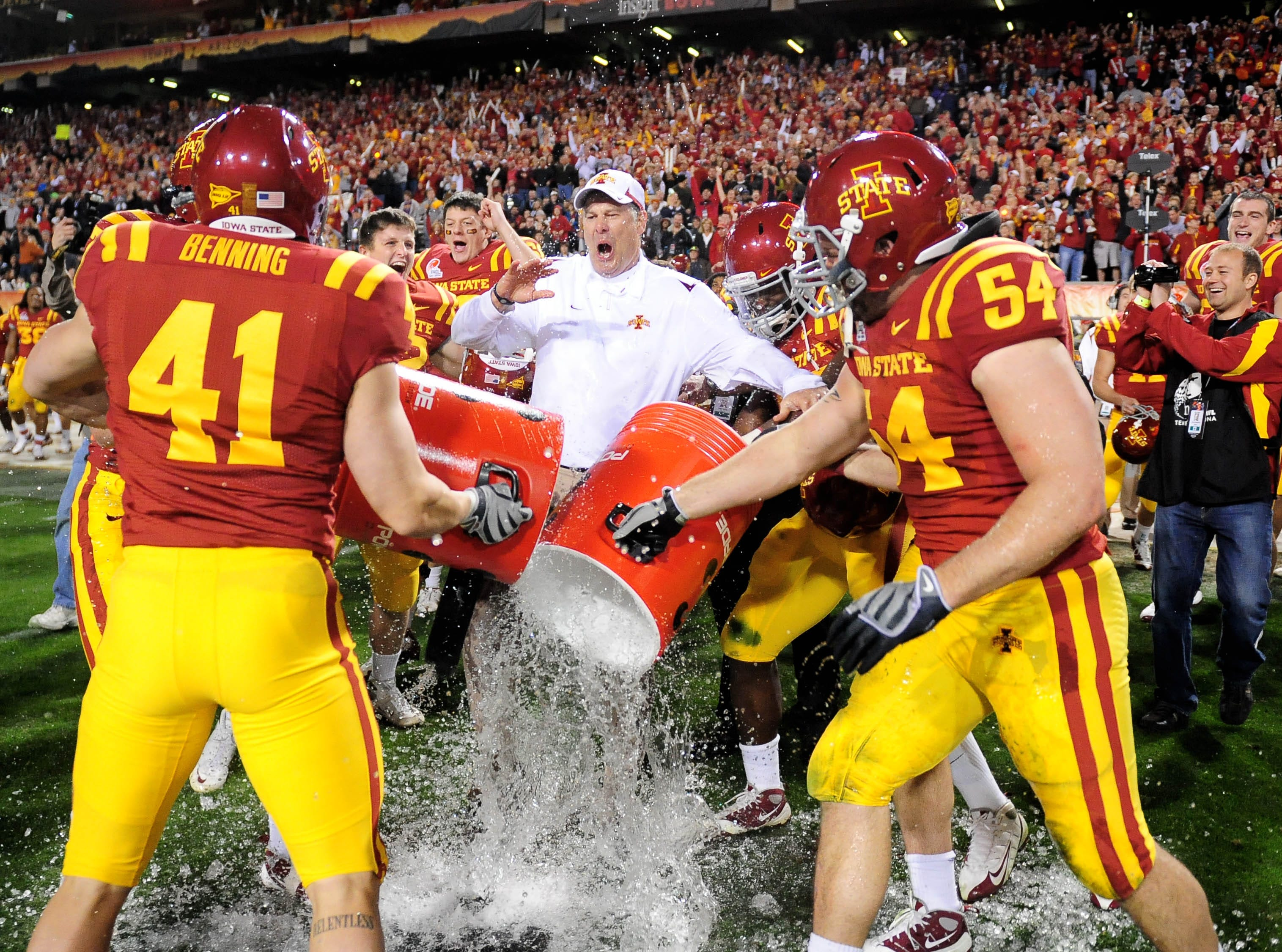 Dec 31, 2009; Tempe, AZ, USA; Iowa State Cyclones head coach Paul Rhoads is doused with water following the game against the Minnesota Golden Gophers in the 2009 Insight Bowl at Sun Devil Stadium. Iowa State defeated Minnesota 14-13. Mandatory Credit: Mark J. Rebilas-USA TODAY Sports