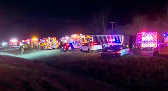 This frame grab from video by WEEK/WHOI shows emergency vehicles at the scene where a semitrailer heading the wrong way on an interstate collided head-on with a school bus carrying members of an Illinois high school girls' basketball team late Wednesday, Dec. 5, 2017, near Downs, Illinois.