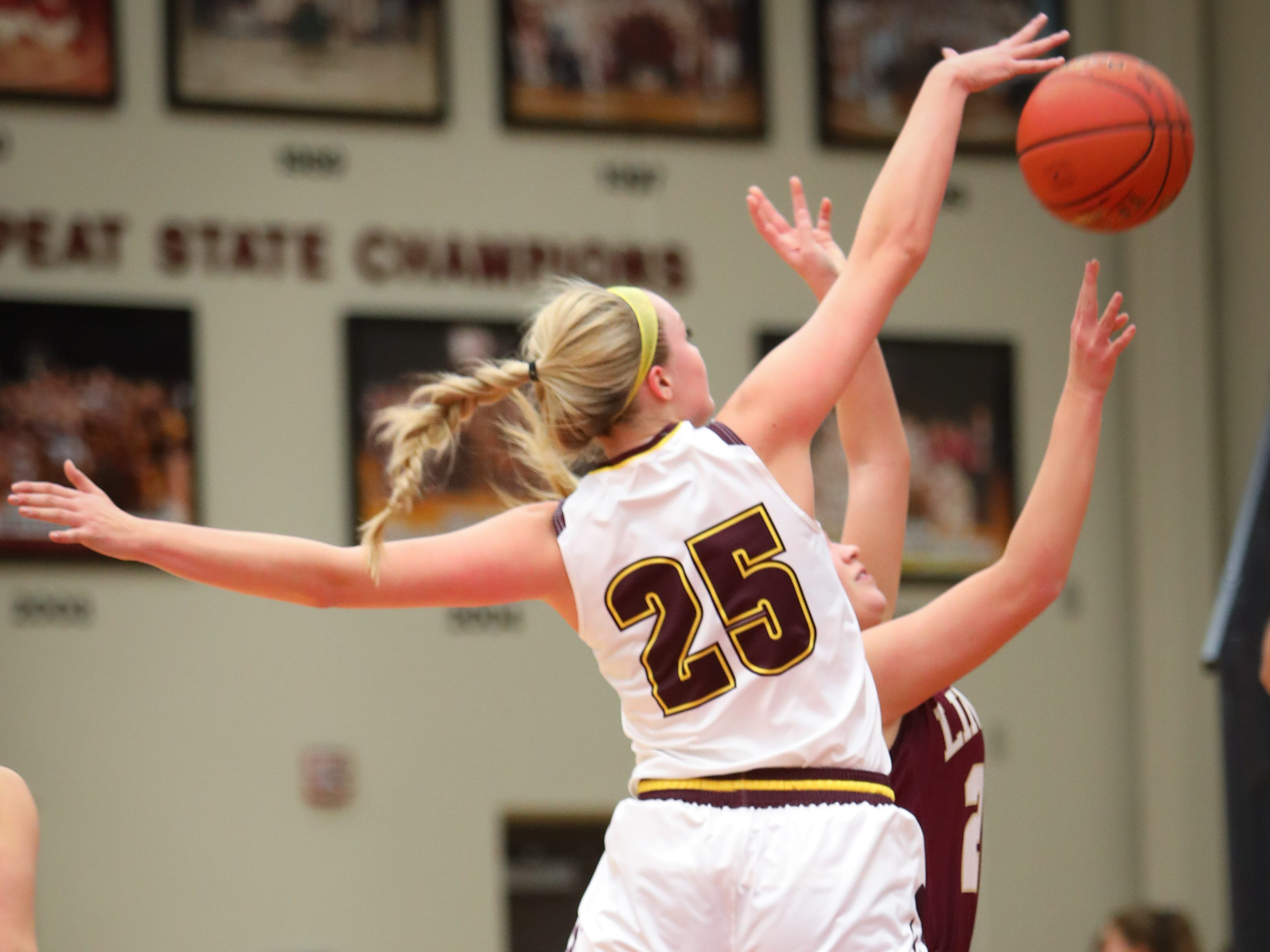 Ankeny senior Sara McCullough blocks the ball during a girls high school basketball game between the Lincoln Railsplitters and the Ankeny Hawks at Ankeny High School on Dec. 4, 2018 in Ankeny, Iowa.