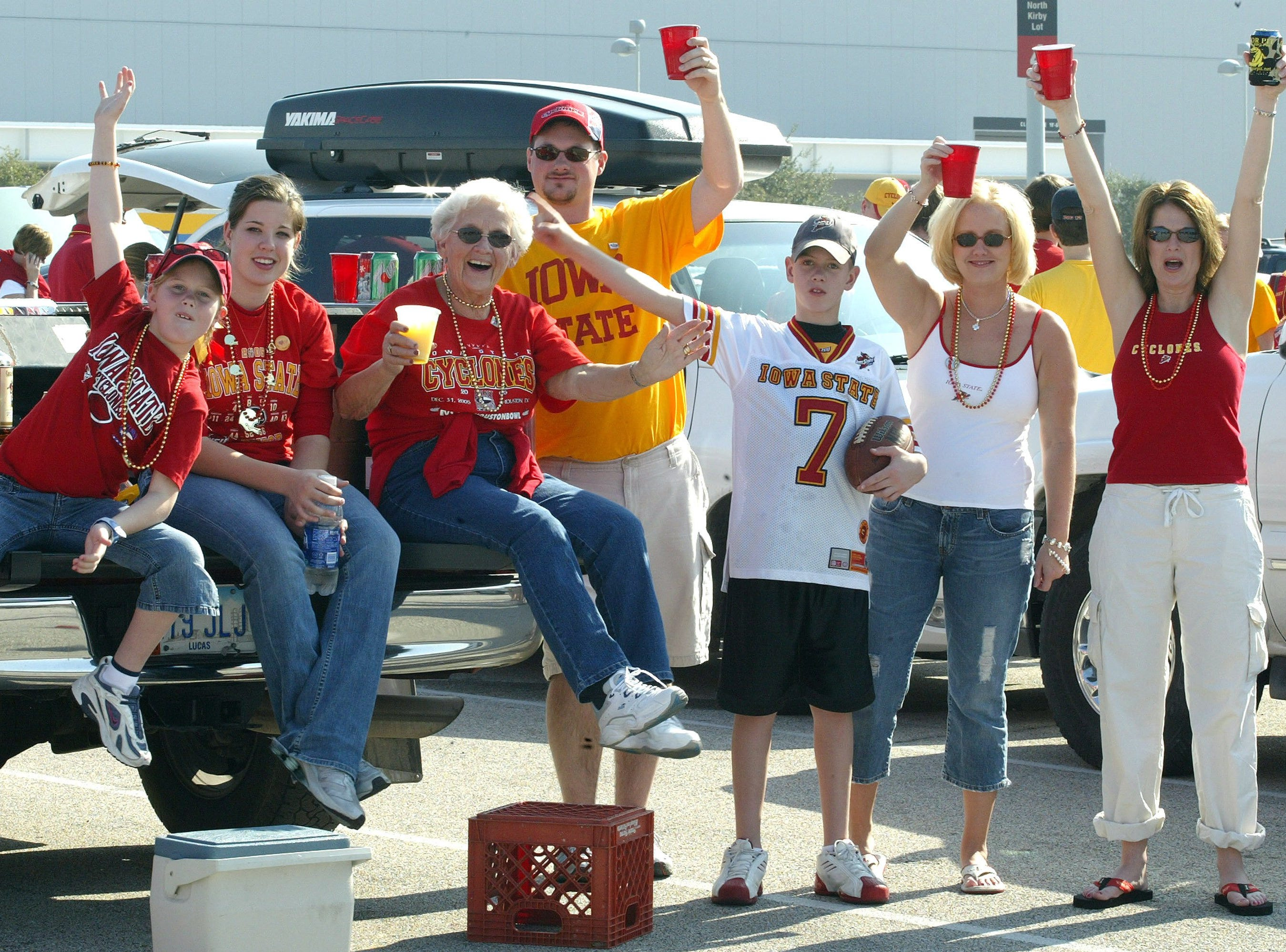 The Burgett clan tailgates in the parking lot before the 2005 Houston Bowl. Age ranges from Grandpa Gene, 75, (not shown) to Josie, 8, far left. They are from Pleasantville, Chariton and Altoona.
