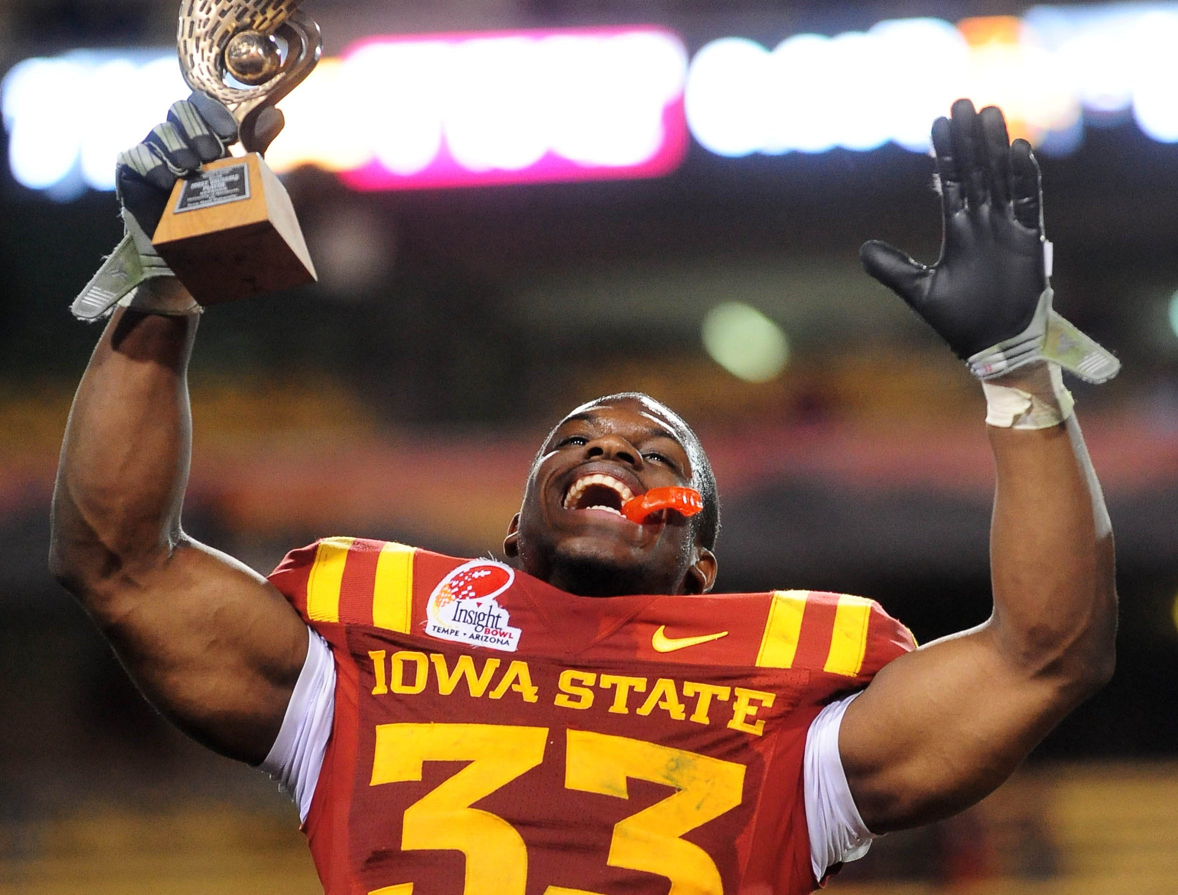 Dec 31, 2009; Tempe, AZ, USA; Iowa State Cyclones running back Alexander Robinson celebrates with the offensive player of the game trophy following the game against the Minnesota Golden Gophers in the 2009 Insight Bowl at Sun Devil Stadium. Iowa State defeated Minnesota 14-13. Mandatory Credit: Mark J. Rebilas-USA TODAY Sports