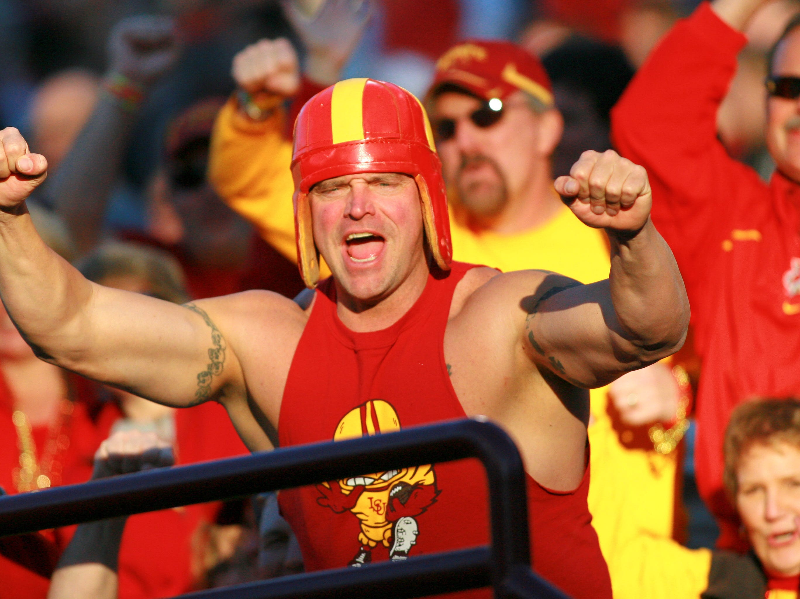 Dec 31, 2009; Tempe, AZ, USA; An Iowa State Cyclones fan cheers on his team in the 1st quarter of a game against the Minnesota Golden Gophers in the 2009 Insight Bowl at Sun Devil Stadium.  Mandatory Credit: Chris Morrison-USA TODAY Sports