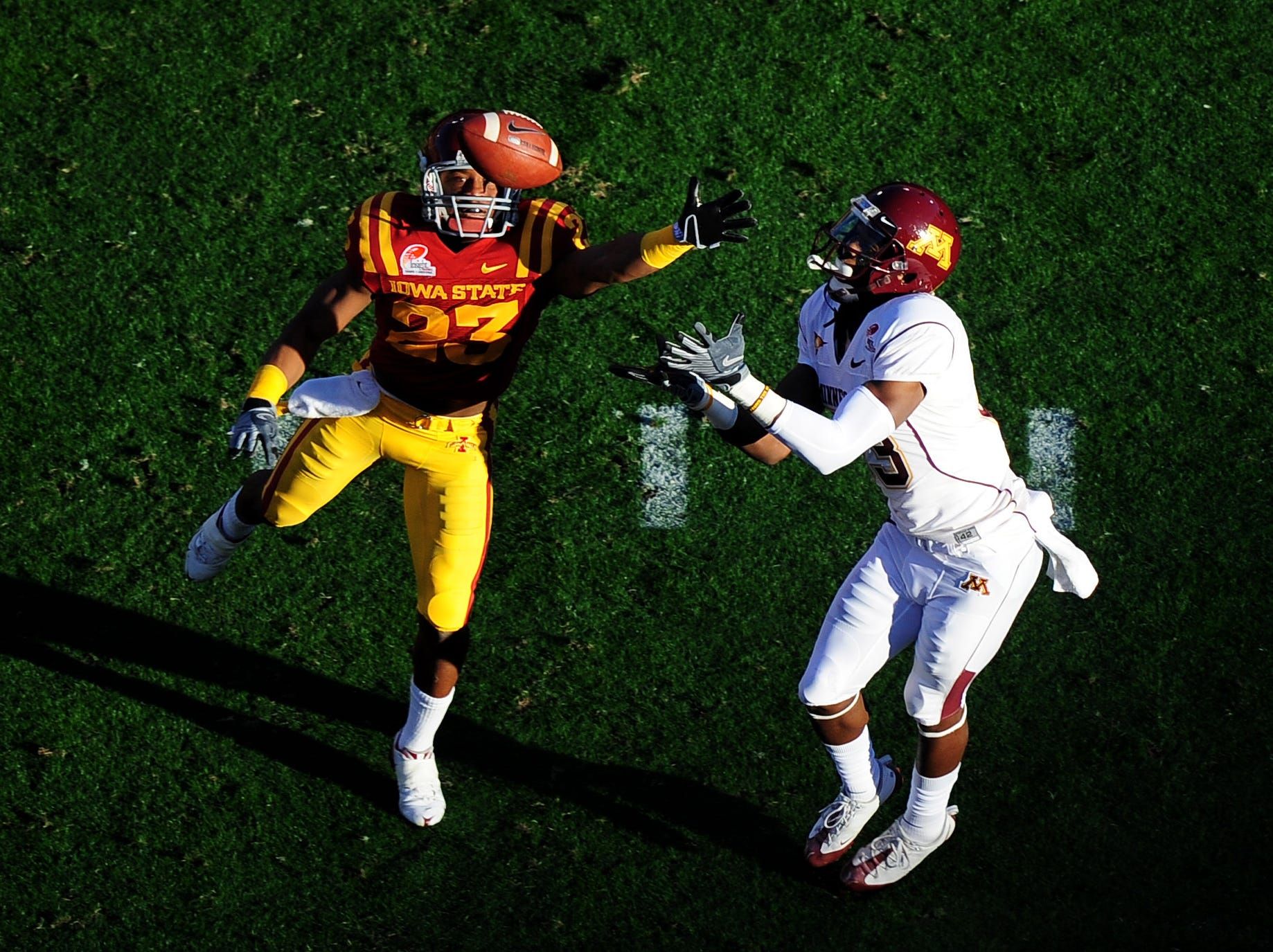 Dec 31, 2009; Tempe, AZ, USA; Minnesota Golden Gophers wide receiver (83) Da'Jon McKnight makes a catch under the defense of Iowa State Cyclones defensive back (23) Leonard Johnson in the first quarter of the 2009 Insight Bowl at Sun Devil Stadium. Mandatory Credit: Mark J. Rebilas-USA TODAY Sports