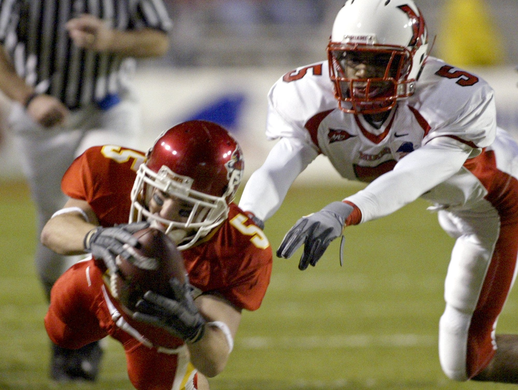Iowa State's Todd Miller dives for extra yardage as Miami's Frank Wiwo defends during the 2004 Independence Bowl in Shreveport, La. Miller's 35-yard punt return, a career best, set up Stevie Hicks' 4-yard touchdown run in the first quarter.