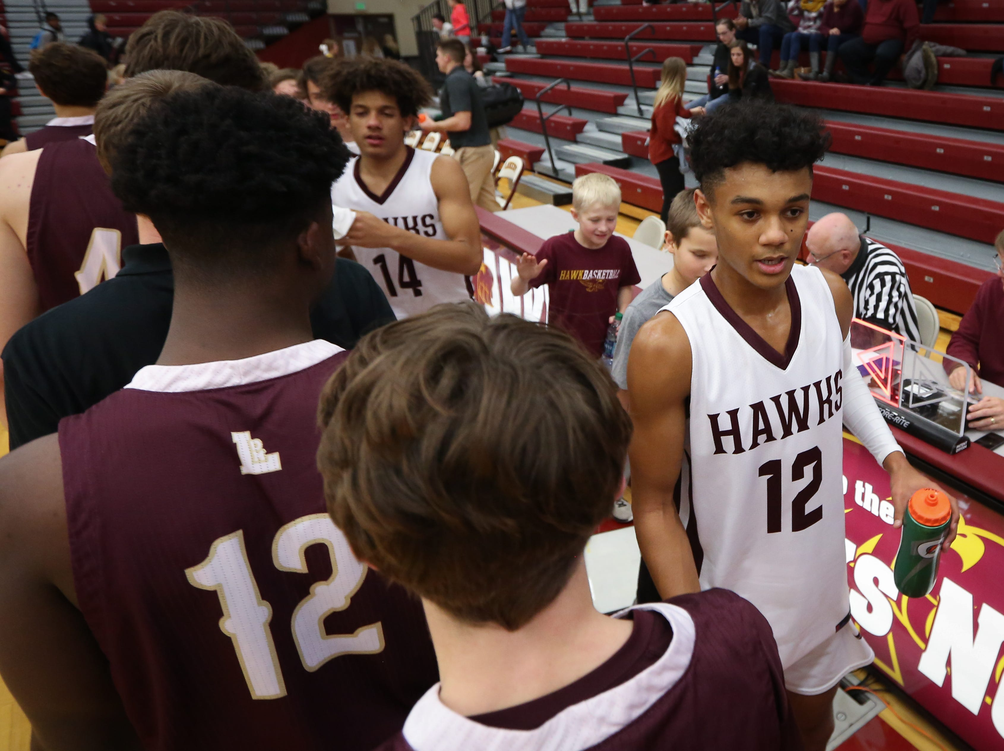 Lincoln junior Jaxon Smith shakes hands with members of the Ankeny Hawks after the Lincoln Railsplitters won, 55-44, in a boys high school basketball game between the Lincoln Railsplitters and the Ankeny Hawks at Ankeny High School on Dec. 4, 2018 in Ankeny, Iowa.