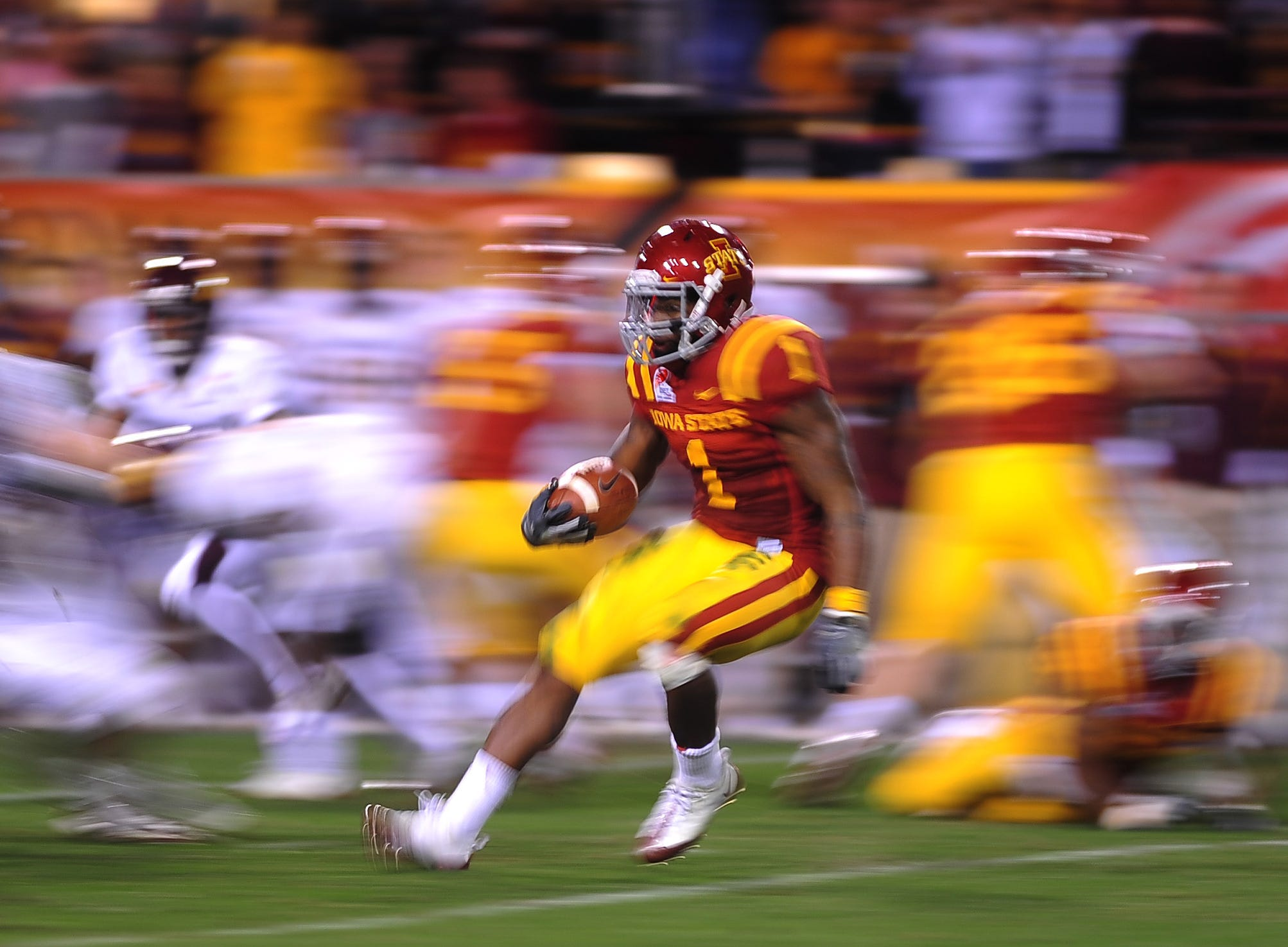 Dec 31, 2009; Tempe, AZ, USA; Iowa State Cyclones running back (1) David Sims runs the ball in the second half against the Minnesota Golden Gophers in the 2009 Insight Bowl at Sun Devil Stadium. Iowa State defeated Minnesota 14-13. Mandatory Credit: Mark J. Rebilas-USA TODAY Sports