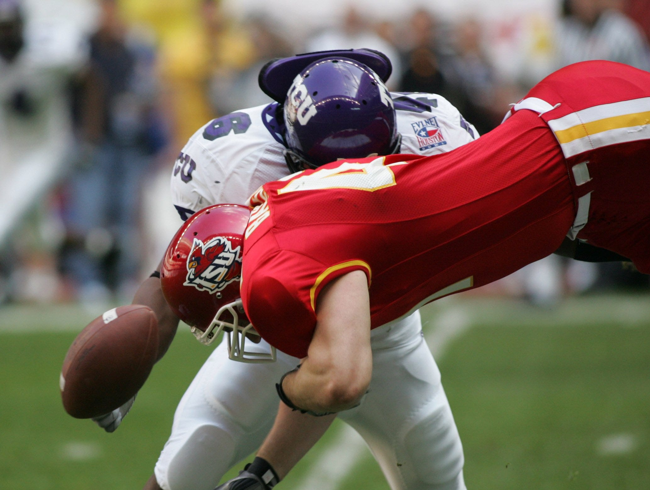 Iowa State tight end Ben Barkema, foreground, fumbles the football against Texas Christian in the first quarter of the 2005 Houston Bowl at Reliant Stadium in Houston, Texas. Barkema made three receptions for 24 yards.