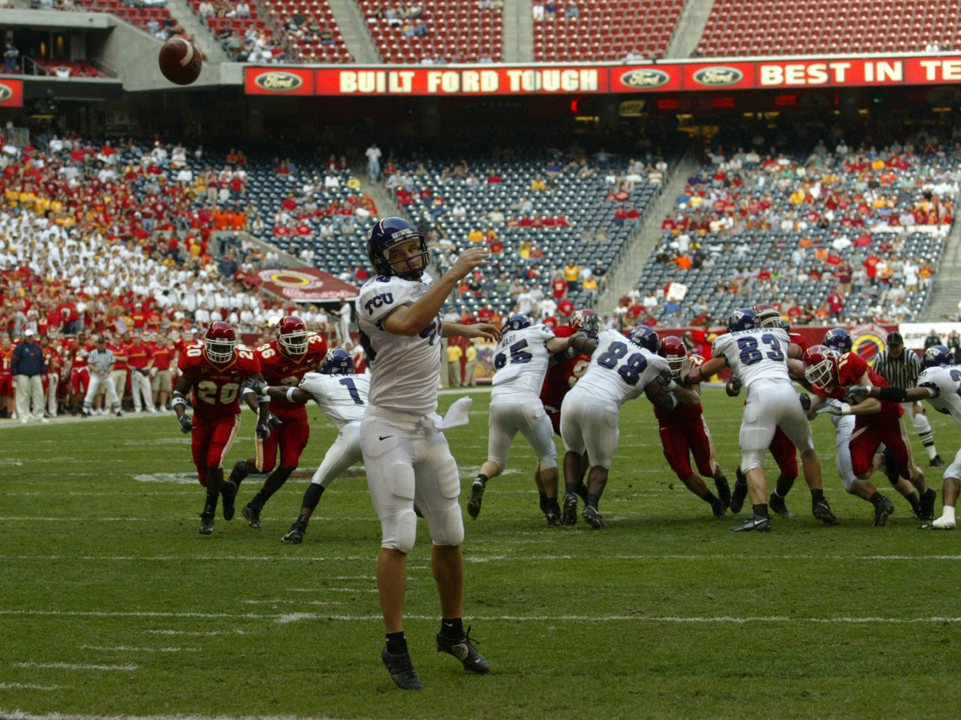 Texas Christian punter Brian Cortney watches helplessly as the ball is snapped over his head for a safety at Reliant Stadium during the 2005 Houston Bowl.