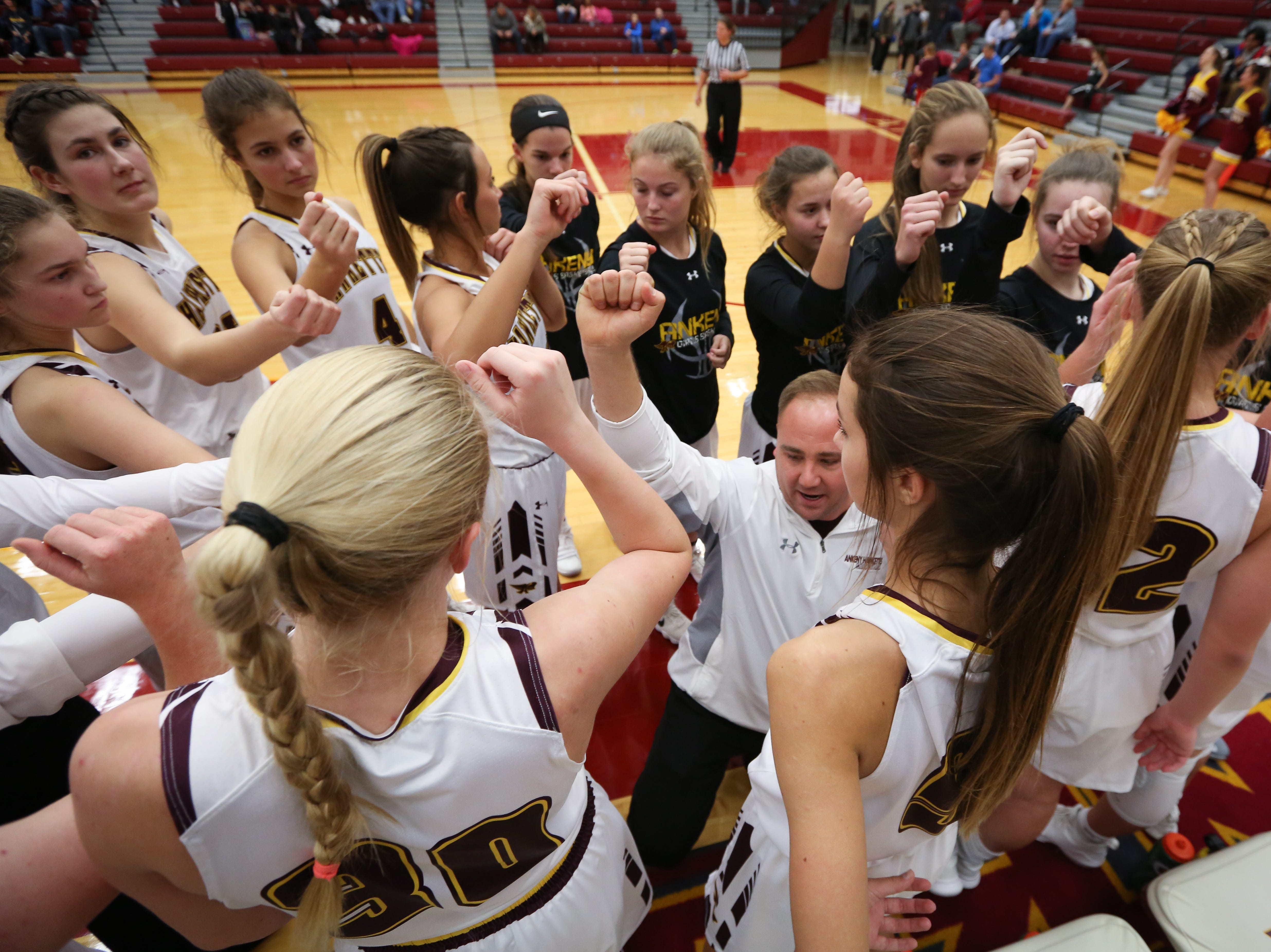 Ankeny head coach Dru McAnelly fires up his players during a girls high school basketball game between the Lincoln Railsplitters and the Ankeny Hawks at Ankeny High School on Dec. 4, 2018 in Ankeny, Iowa.