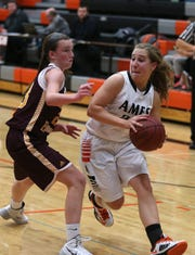 Ames guard Molly Sanders moves the ball up the court against Ankeny in a 2013 game.