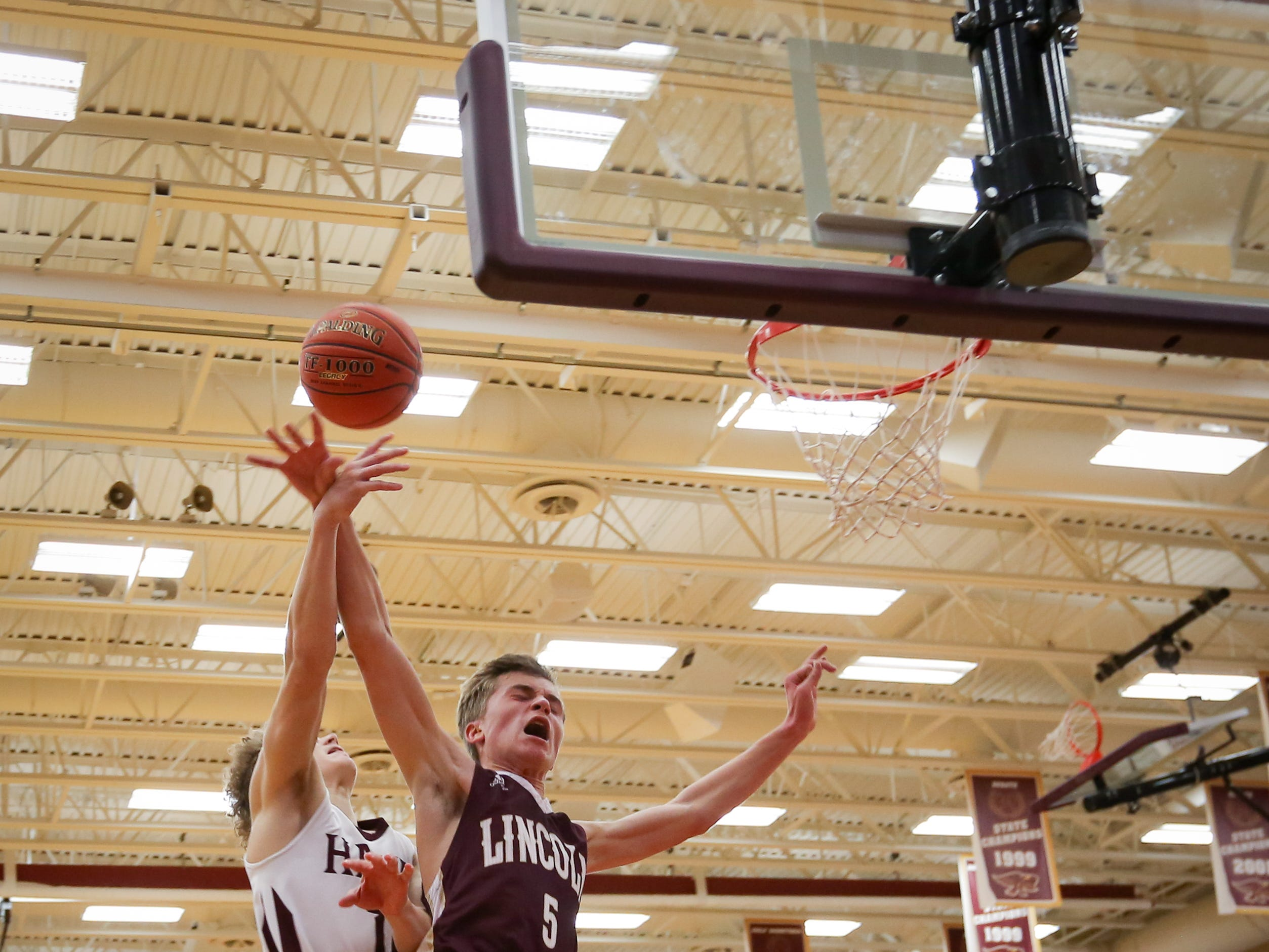 Lincoln Ben Badger gets his shot blocked by Ankeny junior Jordan Kumm during a boys high school basketball game between the Lincoln Railsplitters and the Ankeny Hawks at Ankeny High School on Dec. 4, 2018 in Ankeny, Iowa.