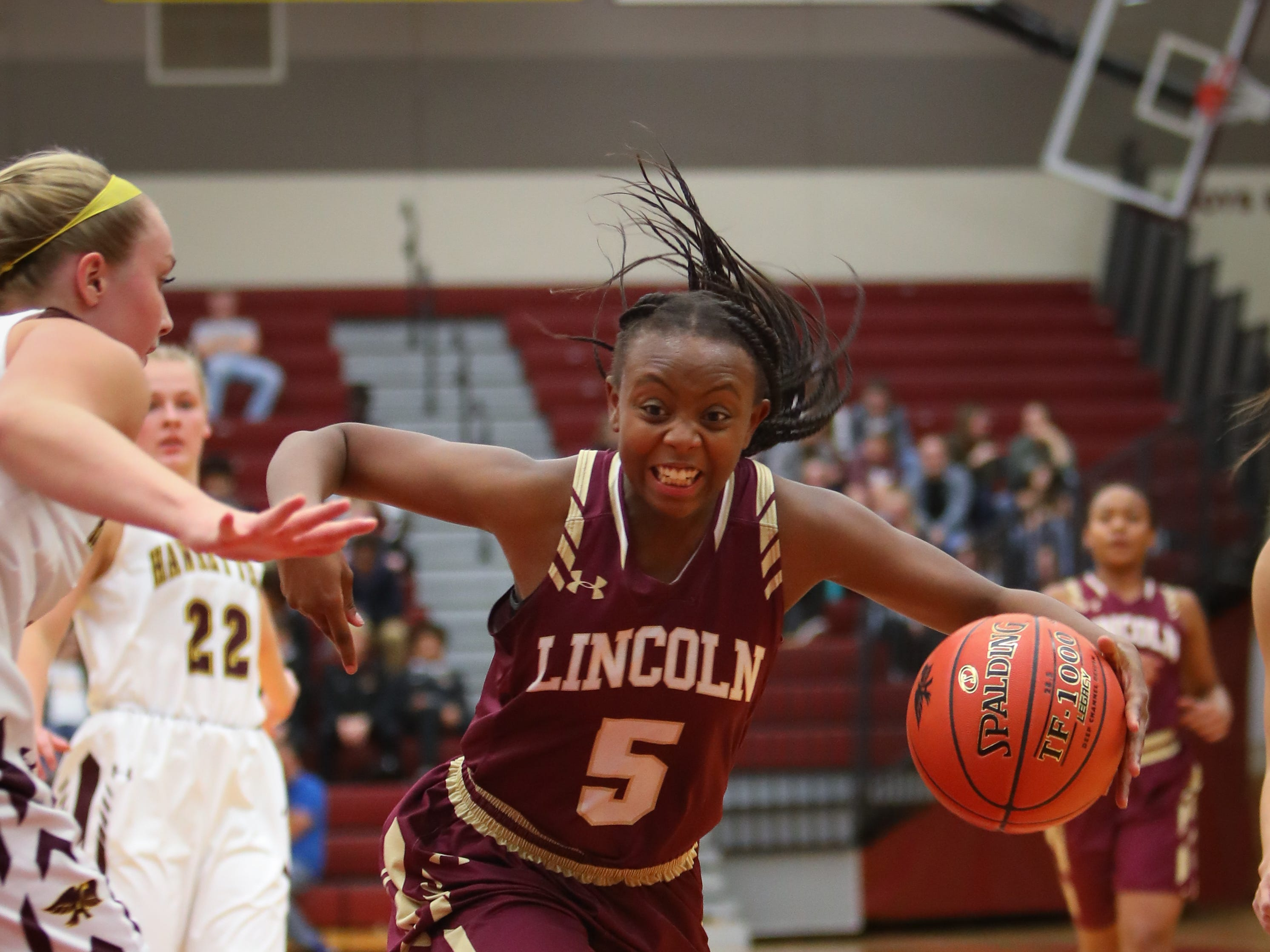 Lincoln freshman Trinity Cheatom drives to the hoop during a girls high school basketball game between the Lincoln Railsplitters and the Ankeny Hawks at Ankeny High School on Dec. 4, 2018 in Ankeny, Iowa.