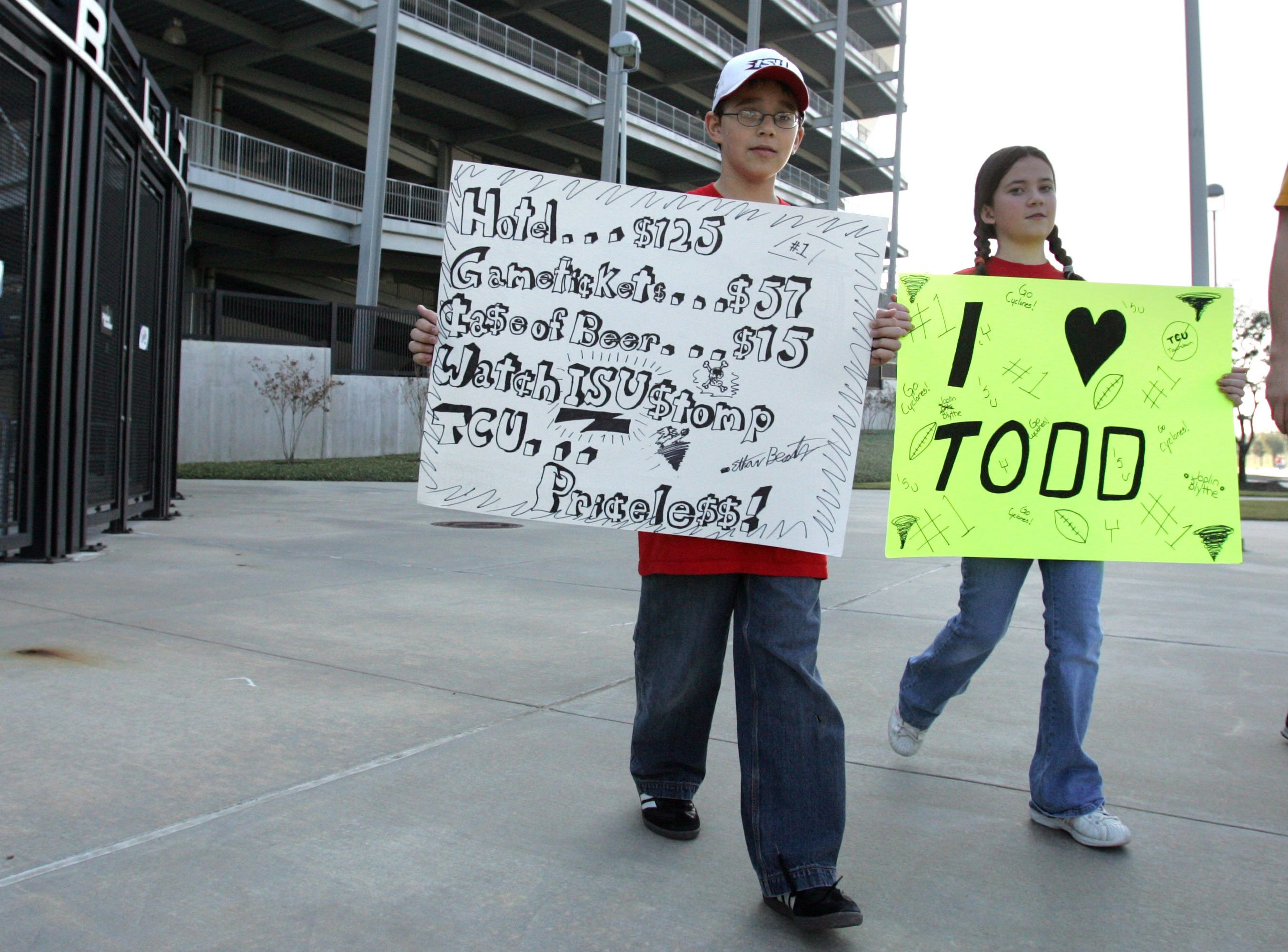 Ethan Beatty, 12, of Keller, Texas, and Joplin Bittle, 12, of Ogden display their Cyclone pride in the parking lot prior to the 2005 Houston Bowl.