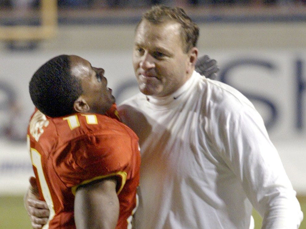 With the final seconds ticking off the clock, Ellis Hobbs celebrates Iowa State's 17-13 victory over Miami of Ohio with head coach Dan McCarney in Shreveport, La. Hobbs intercepted a pass in the closing minute of the game to seal the win for the Cyclones, the first Big 12 team to win the 2004 Independence Bowl.