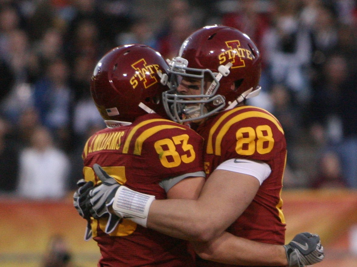 Iowa State's QB Austen Arnaud celebrates with Jake Williams after their last minute touchdown in the Second quarter. His long pass to (83) Jake Williams put the Cyclones up by two touchdowns 14-3.  S0101ISUBowl -Iowa State University played Minnesota in the Insight Bowl in Tempe, Arizona, Thursday, December 31, 2009 at Sun Devil Stadium. (Andrea Melendez/The Register)