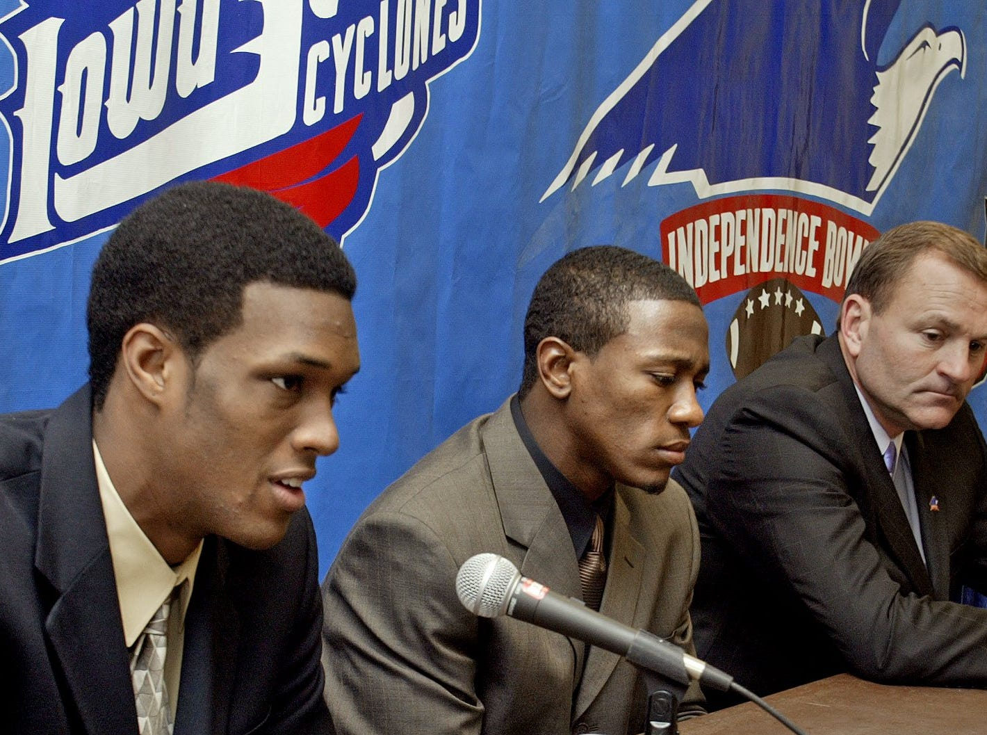 Iowa State coach Dan McCarney, right, with quarterback Bret Meyer, left, and defensive back Ellis Hobbs at a news conference before the 2004 Independence Bowl against Miami (Ohio).