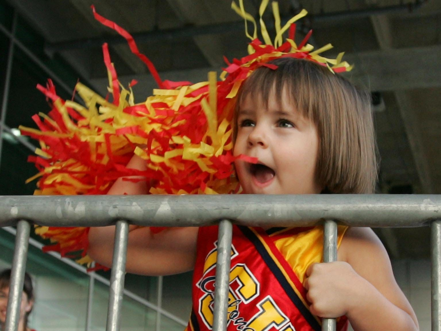 Three-year-old Sienna Kaestner of Newhall cheers and waves her pompom for Iowa State on before the 2005 Houston Bowl.
