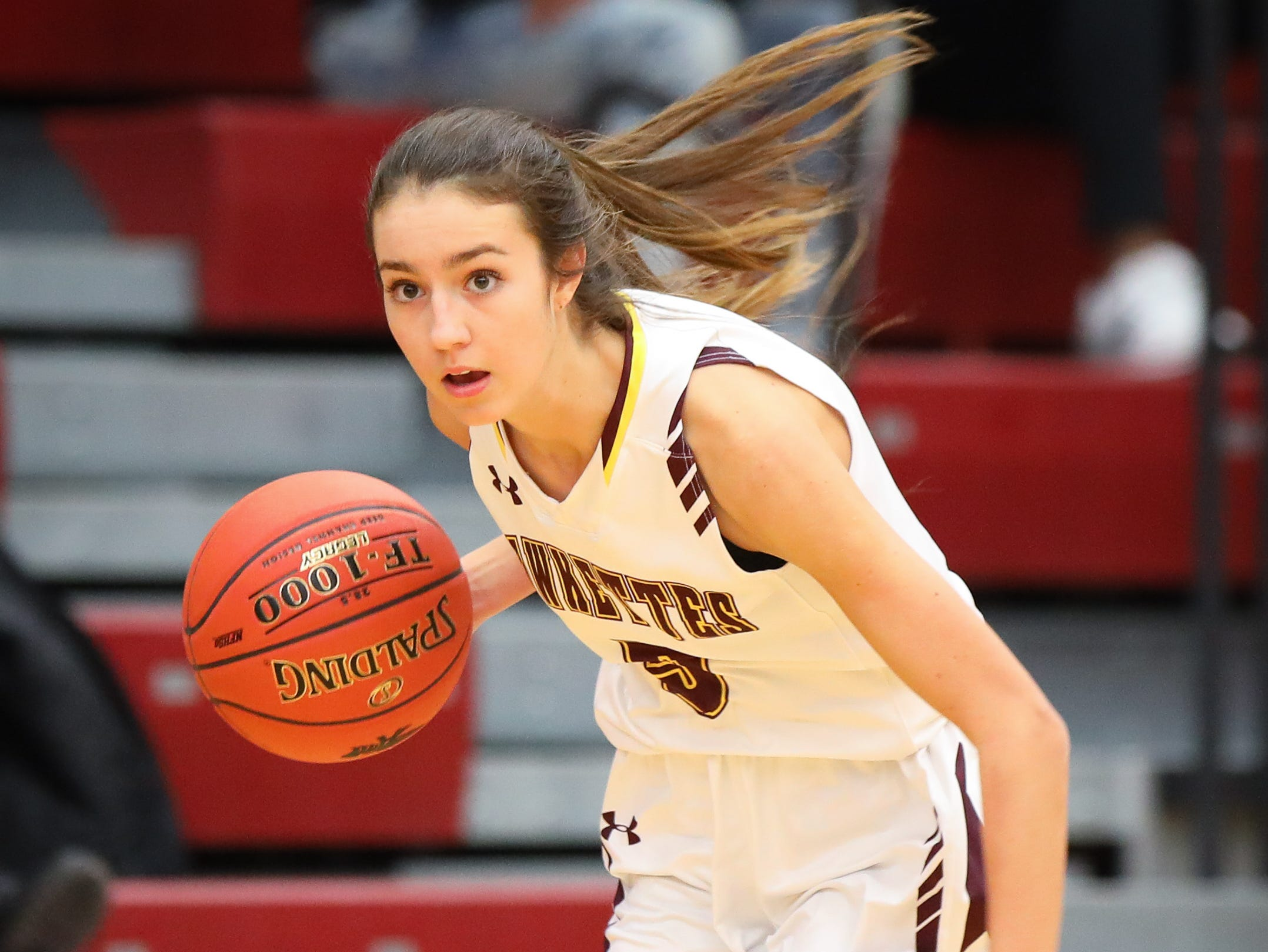 Ankeny junior Kayla Pitz brings the ball up the court during a girls high school basketball game between the Lincoln Railsplitters and the Ankeny Hawks at Ankeny High School on Dec. 4, 2018 in Ankeny, Iowa.