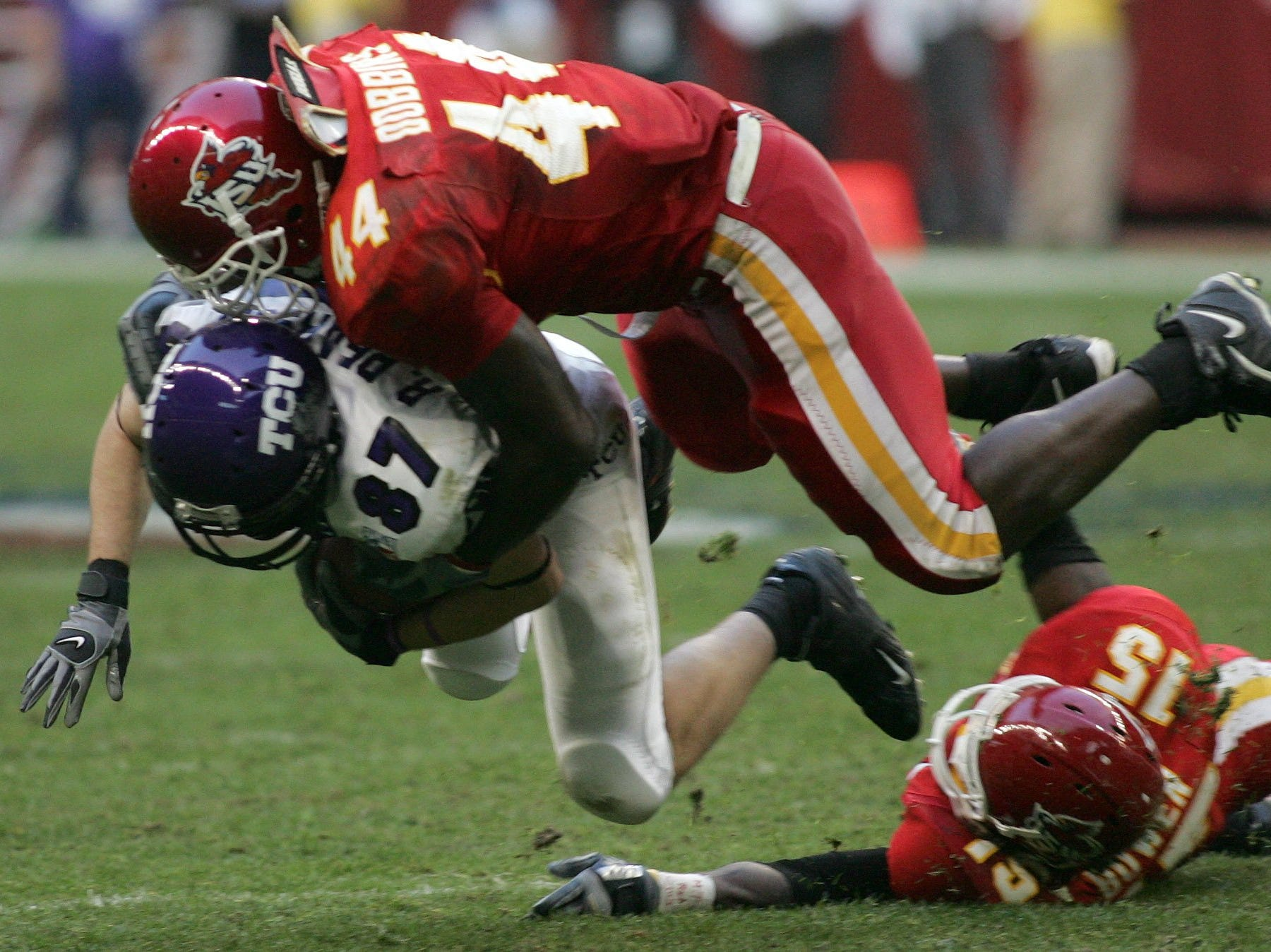 Iowa State's Tim Dobbins brings down Texas Christian receiver Ryan Pearson after a 14-yard gain during the 2005 Houston Bowl.