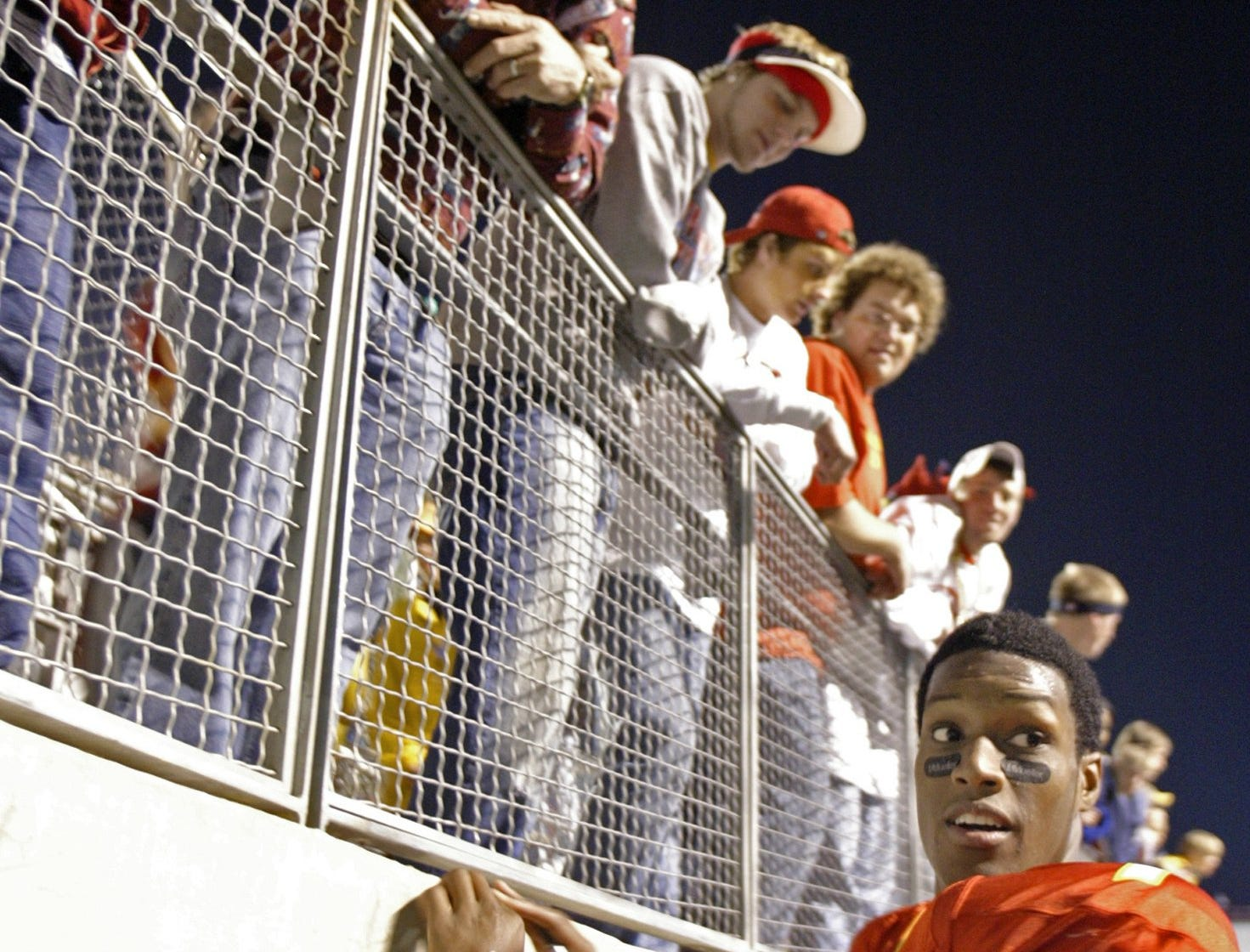 Iowa State quarterback Bret Meyer signs autographs on his way to the locker room after defeating Miami of Ohio, 17-13, in the 2004 Independence Bowl at Shreveport, Louisiana. Meyer, a freshman from Atlantic, earned offensive most valuable player honors after rushing for 122 yards and passing for 114.