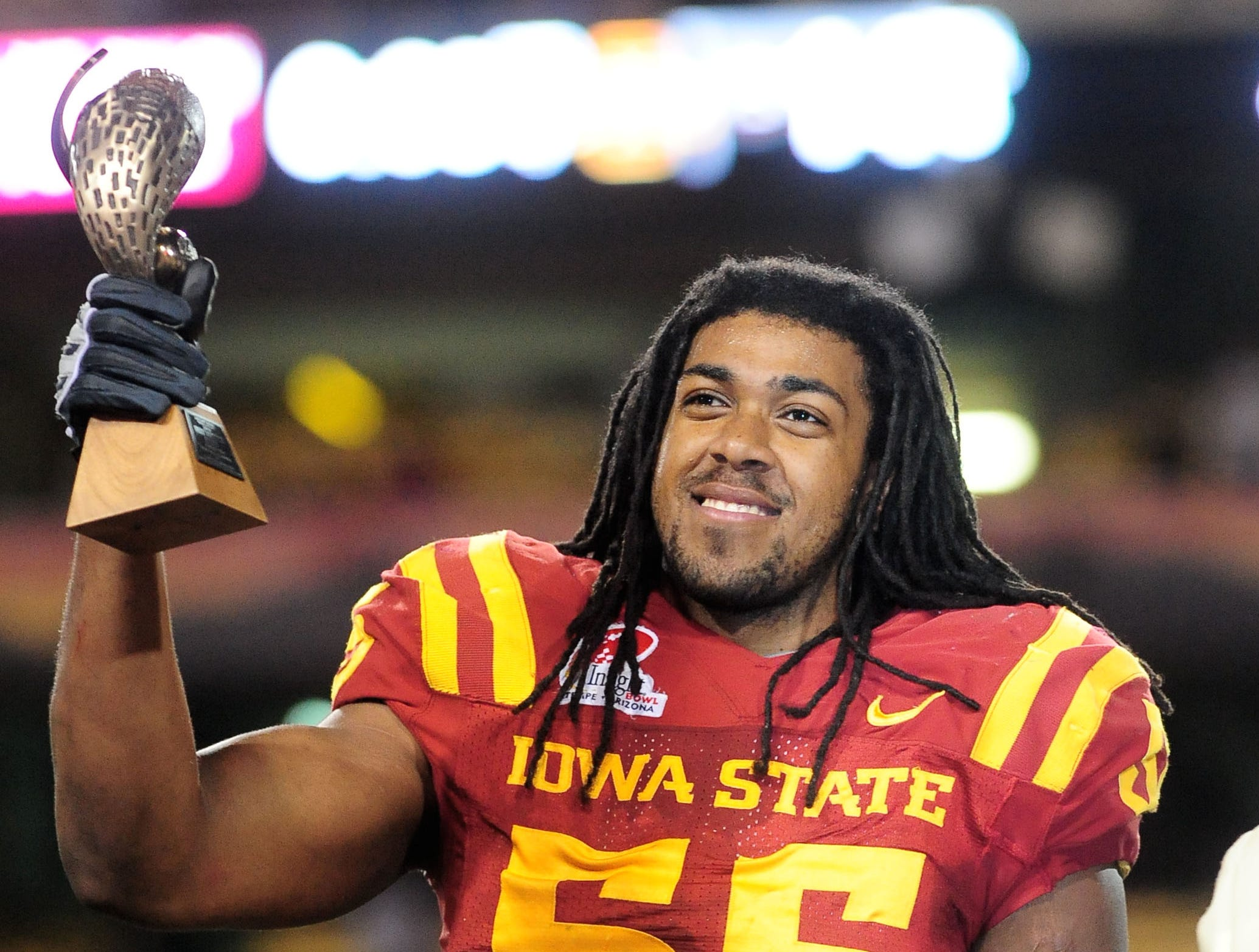 Dec 31, 2009; Tempe, AZ, USA; Iowa State Cyclones defensive end Christopher Lyle celebrates with the defensive player of the game trophy following the game against the Minnesota Golden Gophers in the 2009 Insight Bowl at Sun Devil Stadium. Iowa State defeated Minnesota 14-13. Mandatory Credit: Mark J. Rebilas-USA TODAY Sports