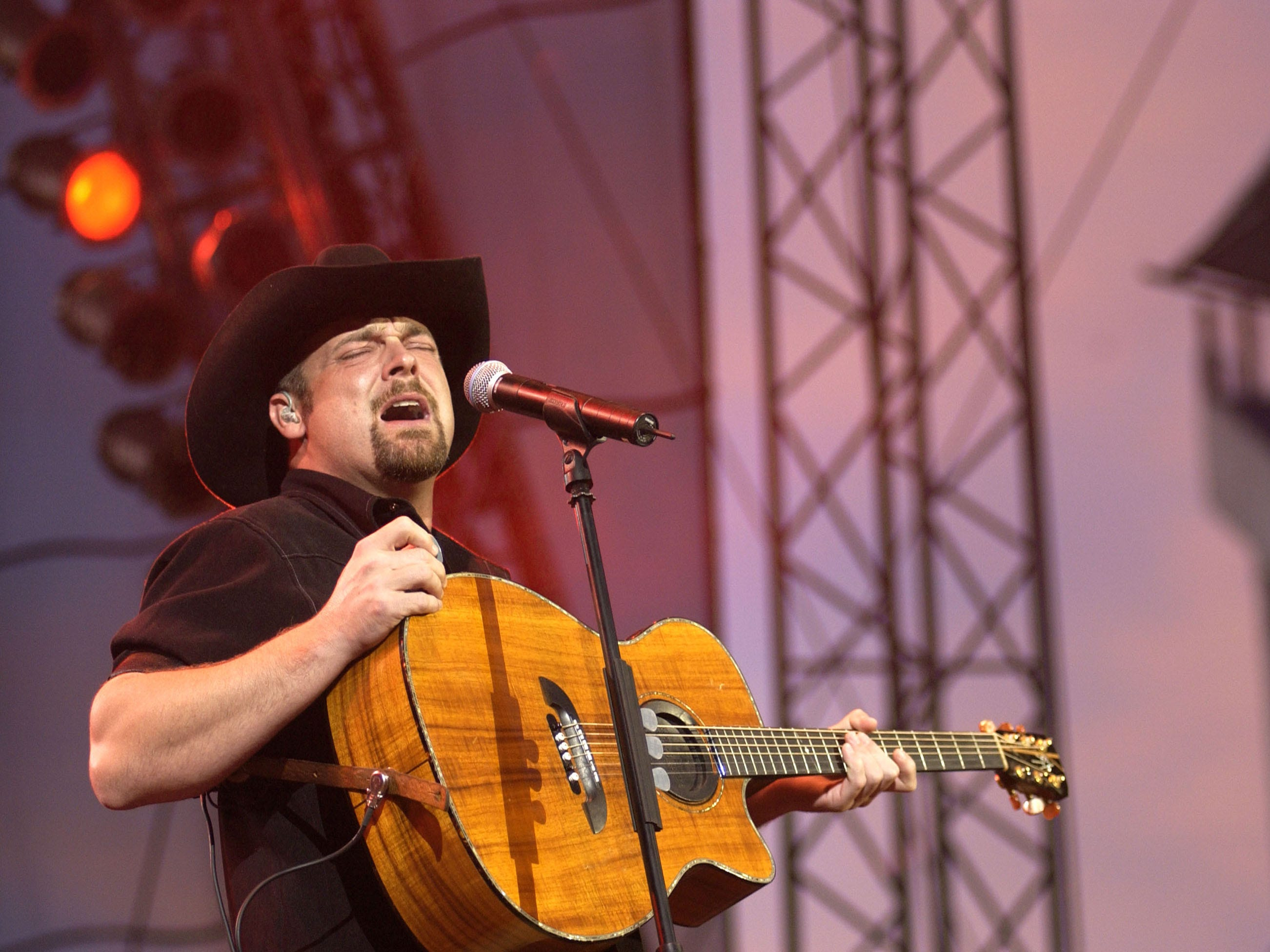 Why a country star is postponing his retirement to headline a small-town Iowa festival