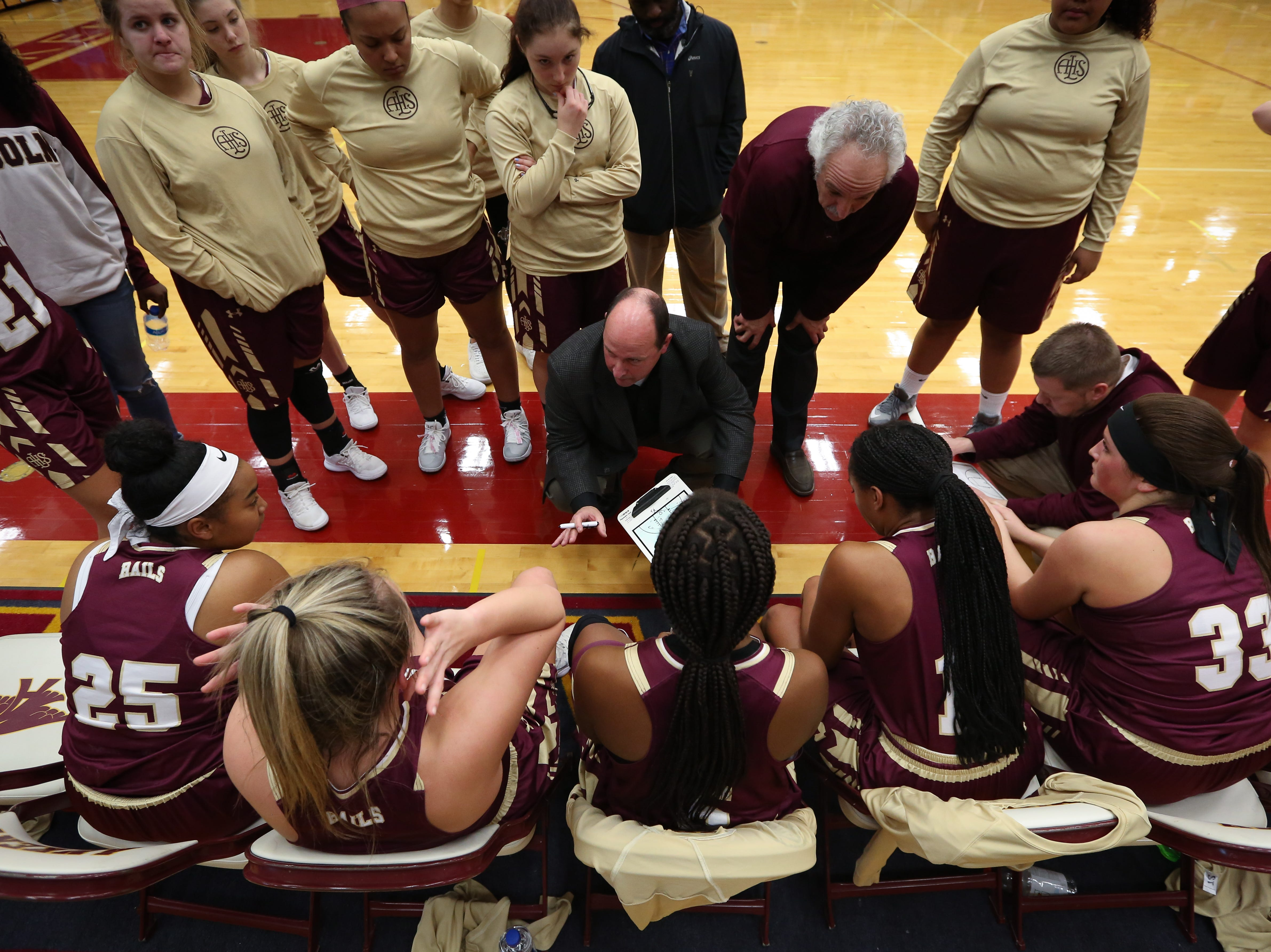 Lincoln head coach Scott Harrison gives instructions to his players during a girls high school basketball game between the Lincoln Railsplitters and the Ankeny Hawks at Ankeny High School on Dec. 4, 2018 in Ankeny, Iowa.