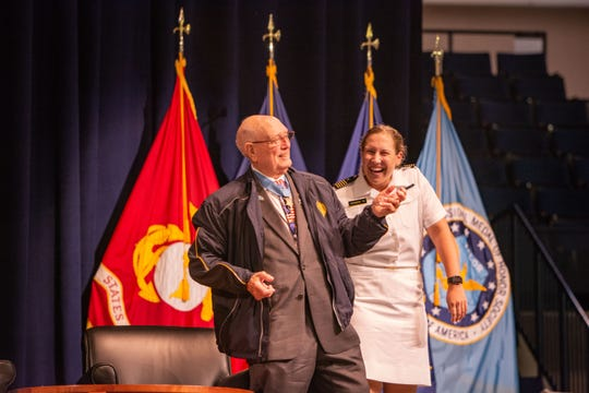 Hershel Williams (left), a Medal of Honor recipient, visited with Molly Sanders at the U.S. Navy Academy during services for Sen. John McCain.