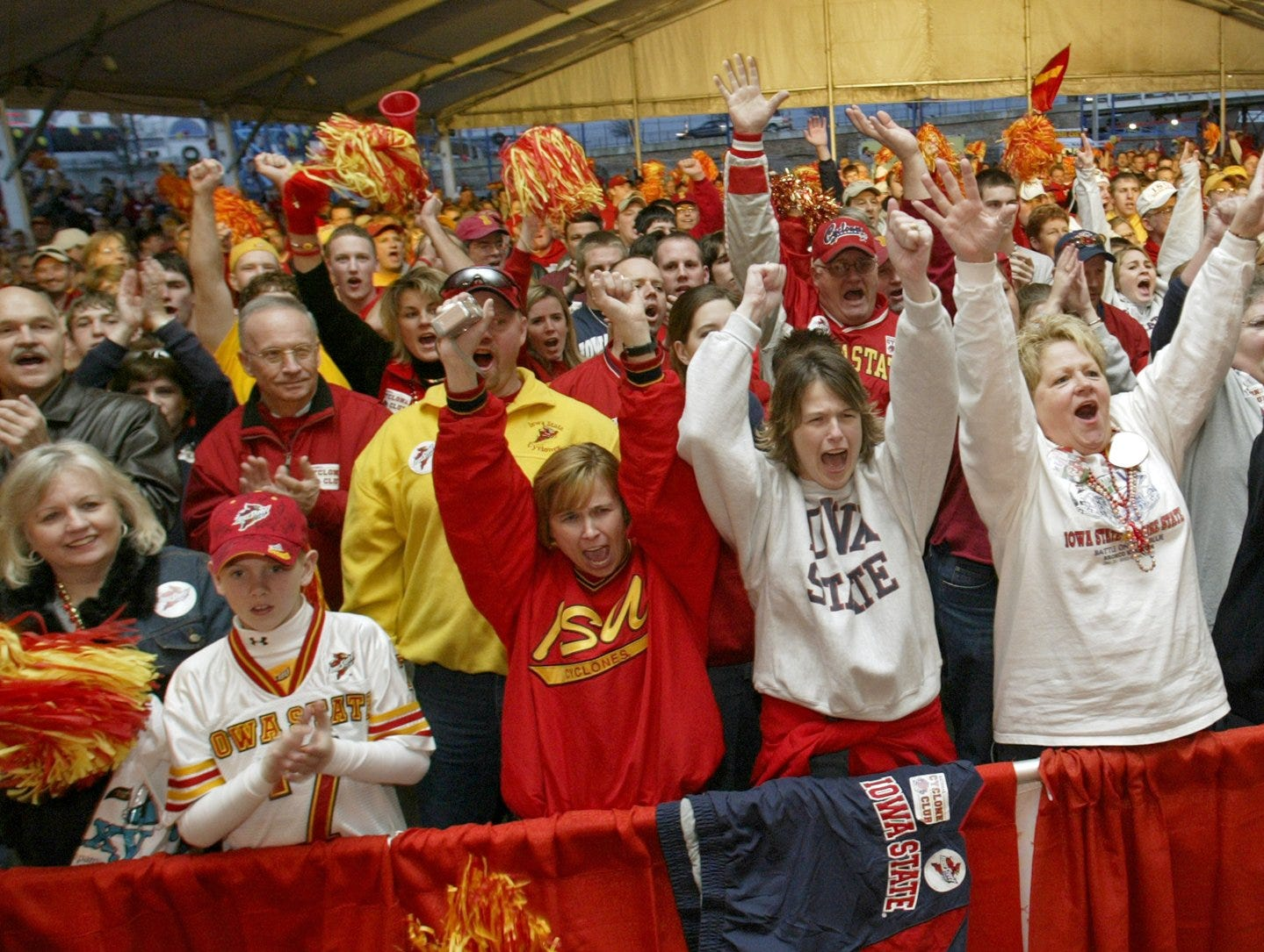 Iowa State fans cheer as Cyclones football players and coaches arrive at a pep rally in downtown Shreveport before the 2004 Independence Bowl.