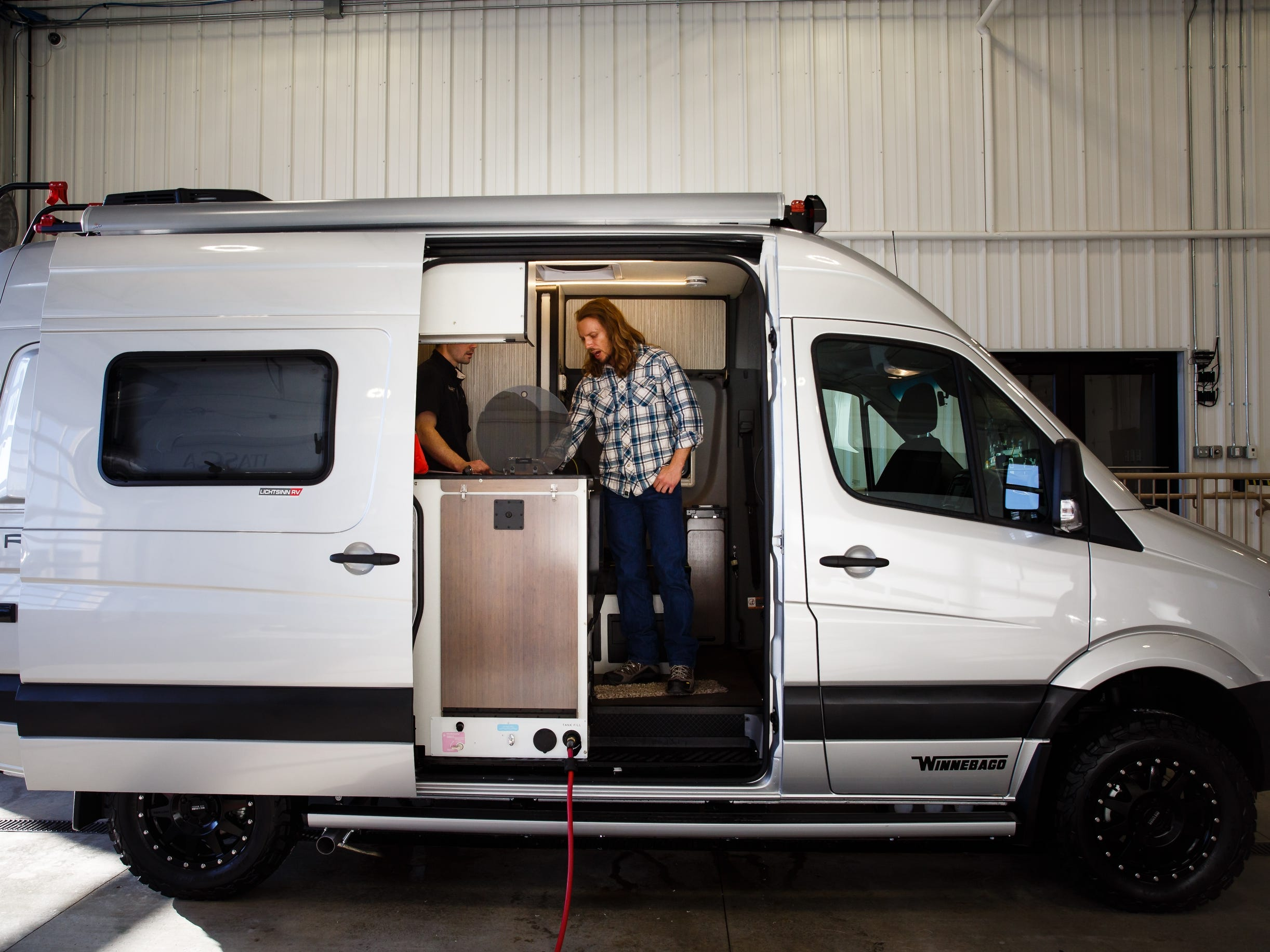 Dustin James Leighton gets a tour of his new Winnebago Revel at Lichtsinn RV on Wednesday, Dec. 5, 2018, in Forest City. Leighton, a voice-over artist, spends a lot of time on the road and said he plans to turn part of the RV into a mobile studio so he can record from the road if he has too.