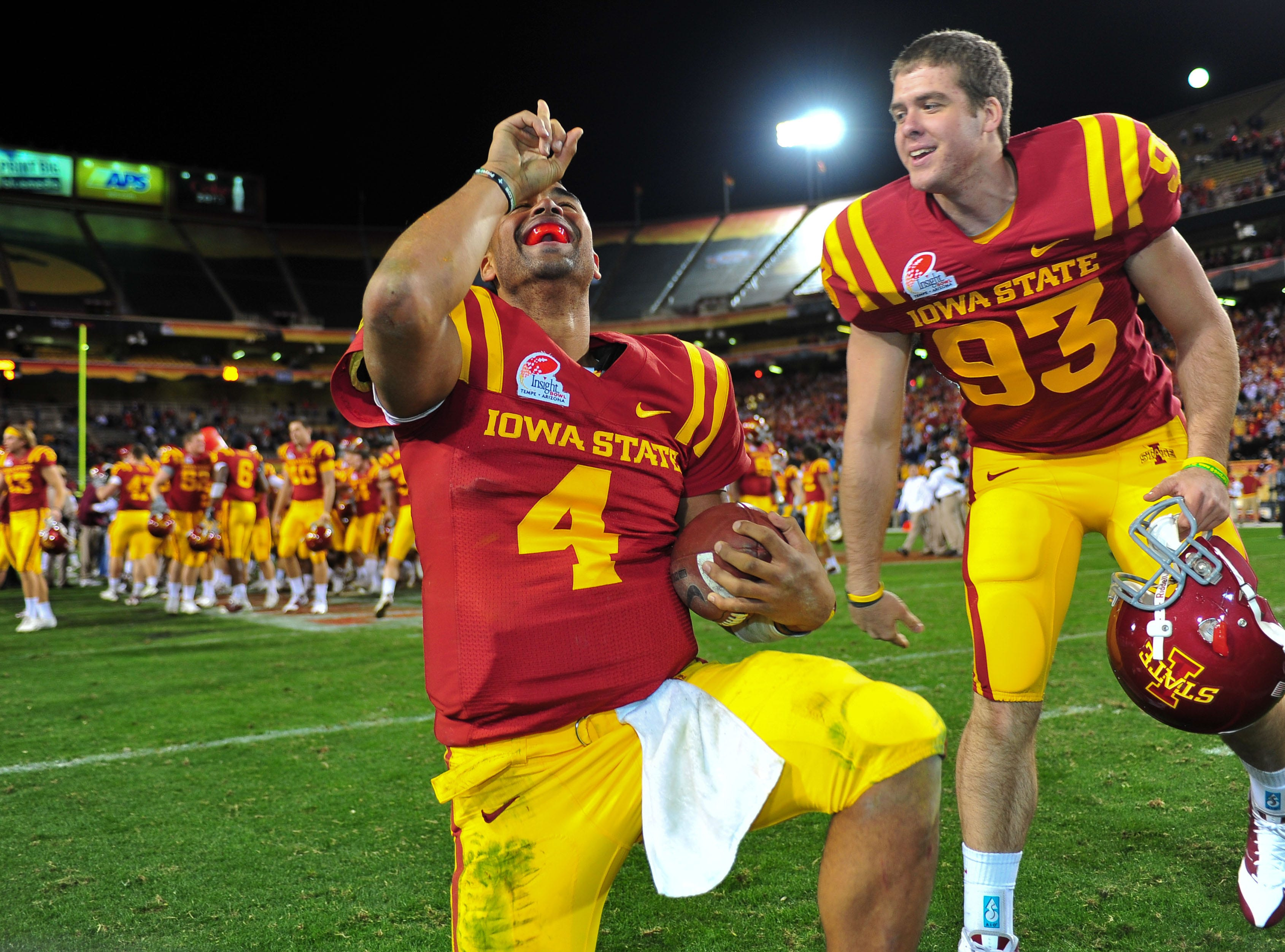 Dec 31, 2009; Tempe, AZ, USA; Iowa State Cyclones quarterback Austen Arnaud (4) and center Sam Anker (93) celebrate their 14-13 victory over the Minnesota Golden Gophers in the 2009 Insight Bowl at Sun Devil Stadium.  Mandatory Credit: Chris Morrison-USA TODAY Sports