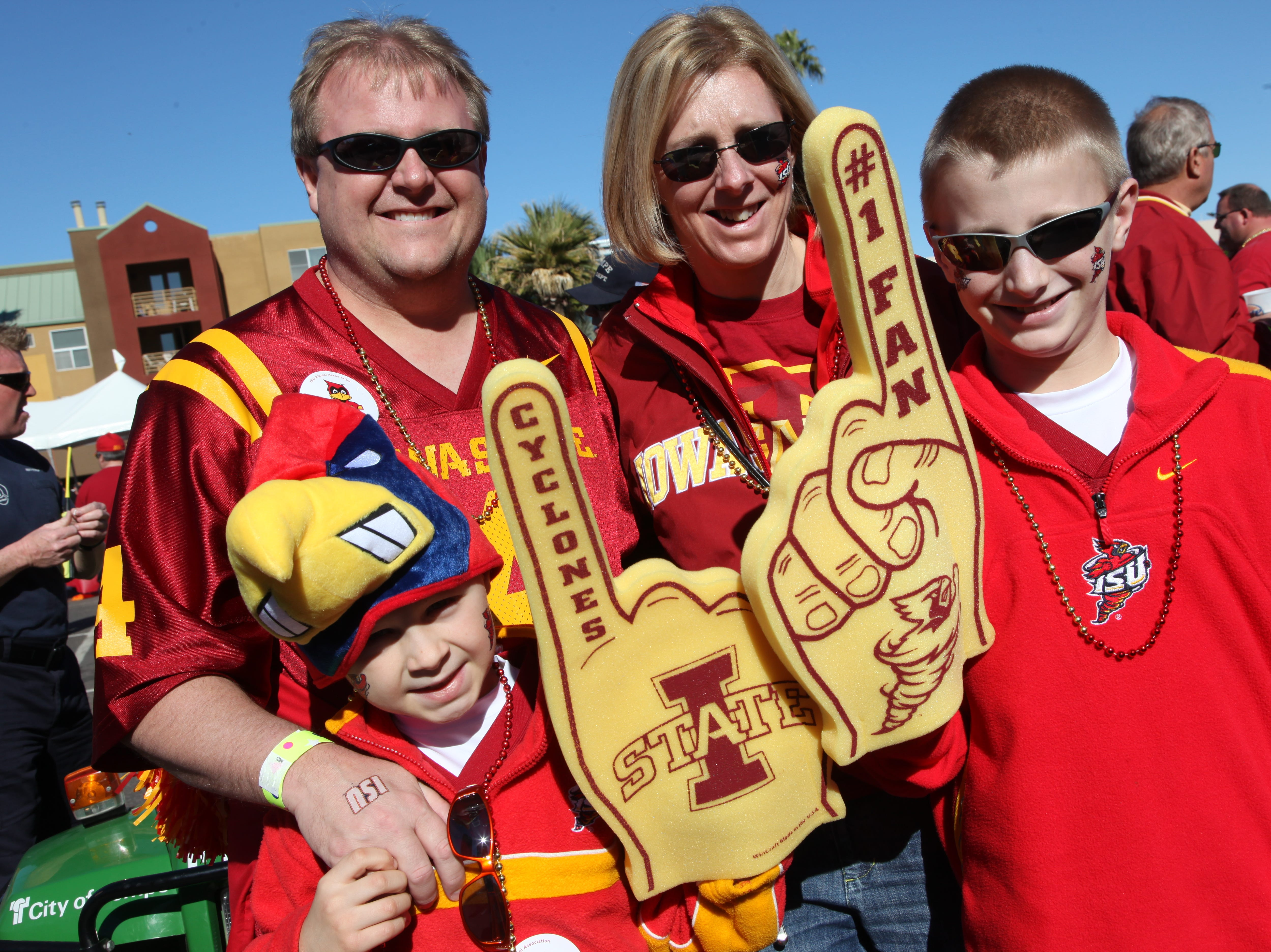 Crew family, Steve, Melissa, Devin, 8, and Skyler, 11, of Urbandale, were ready to cheer on the Cyclones. Steve has been an ISU fan since he was little. S0101ISUBowl -Iowa State University played Minnesota in the Insight Bowl in Tempe, Arizona, Thursday, December 31, 2009 at Sun Devil Stadium. (Andrea Melendez/The Register)