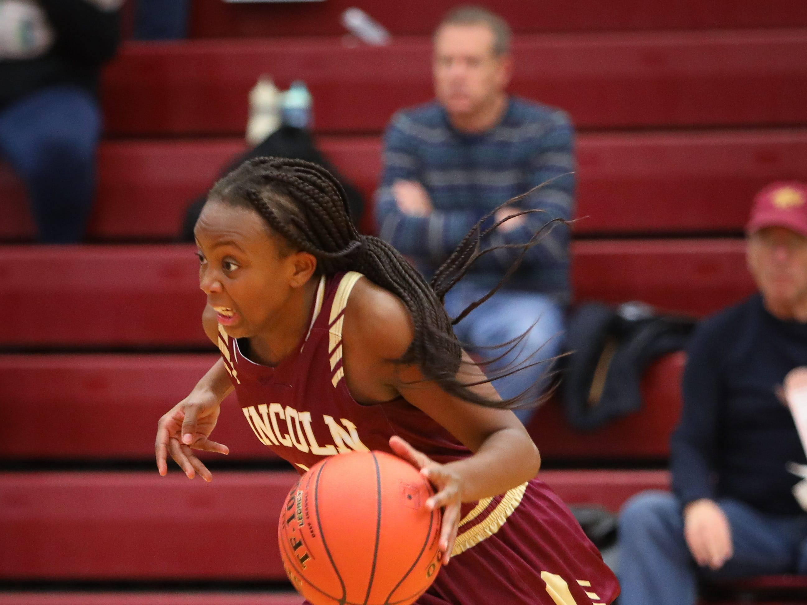 Lincoln freshman Trinity Cheatom begins her drive to the hoop during a girls high school basketball game between the Lincoln Railsplitters and the Ankeny Hawks at Ankeny High School on Dec. 4, 2018 in Ankeny, Iowa.