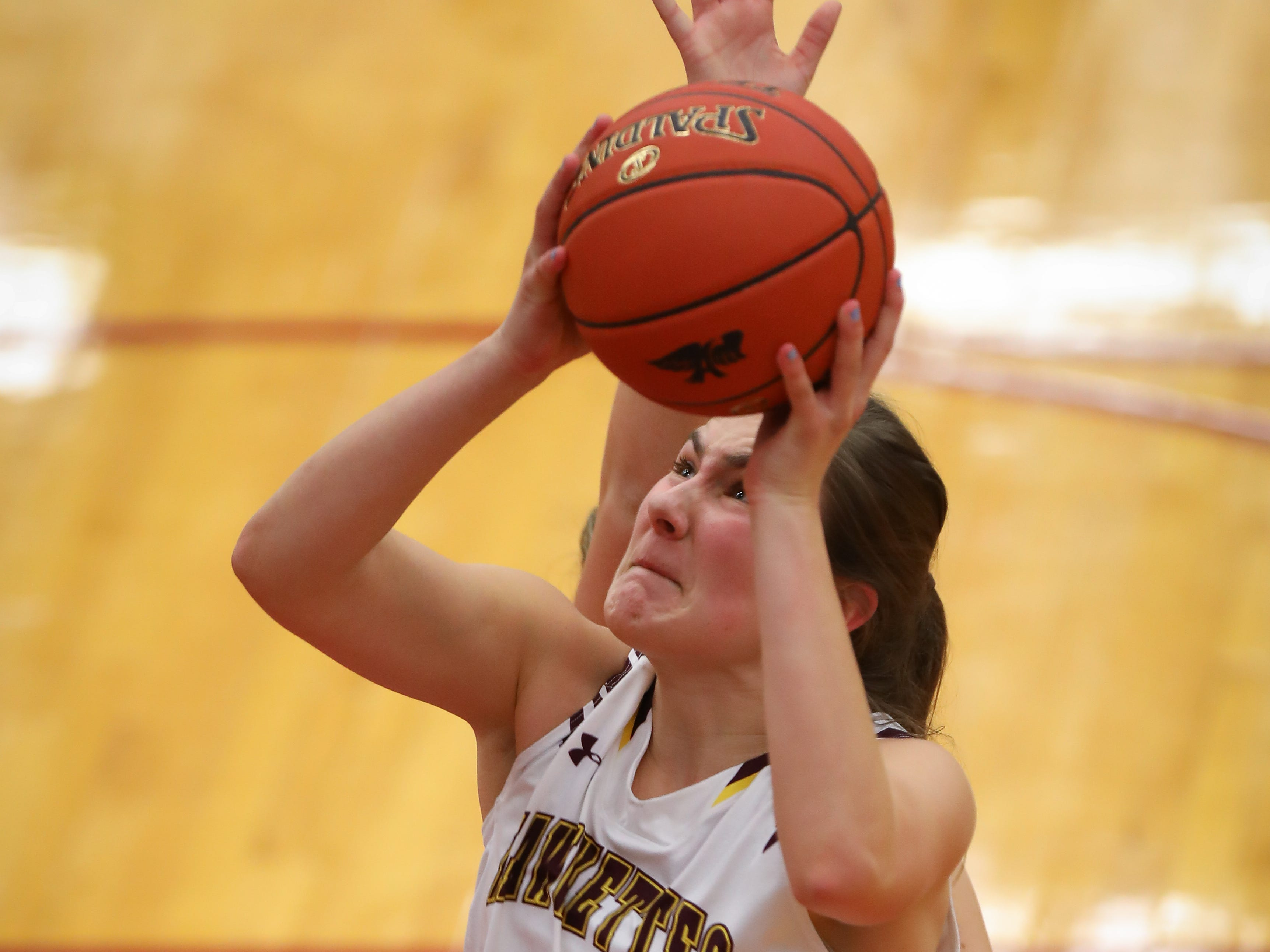 Ankeny junior Isabelle Vacek goes for a lay-up during a girls high school basketball game between the Lincoln Railsplitters and the Ankeny Hawks at Ankeny High School on Dec. 4, 2018 in Ankeny, Iowa.