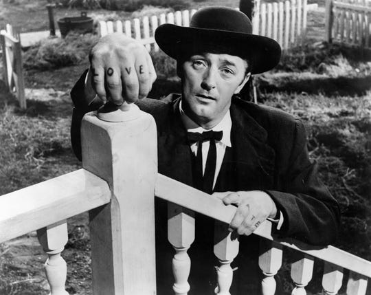 "Robert Mitchum plays a scheming ex-con in ""The Night of the Hunter,"" which premiered in Des Moines 60 years ago thanks to a native Iowan as its producer."