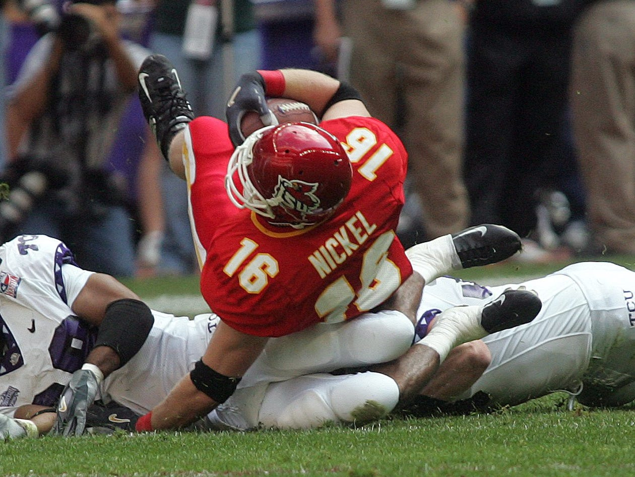 From 2005: An apparent long gain by Walter Nickel of Iowa State was nullified when Houston Bowl game officials ruled him down after reviewing the play against TCU. TCU won the game, 27-24.