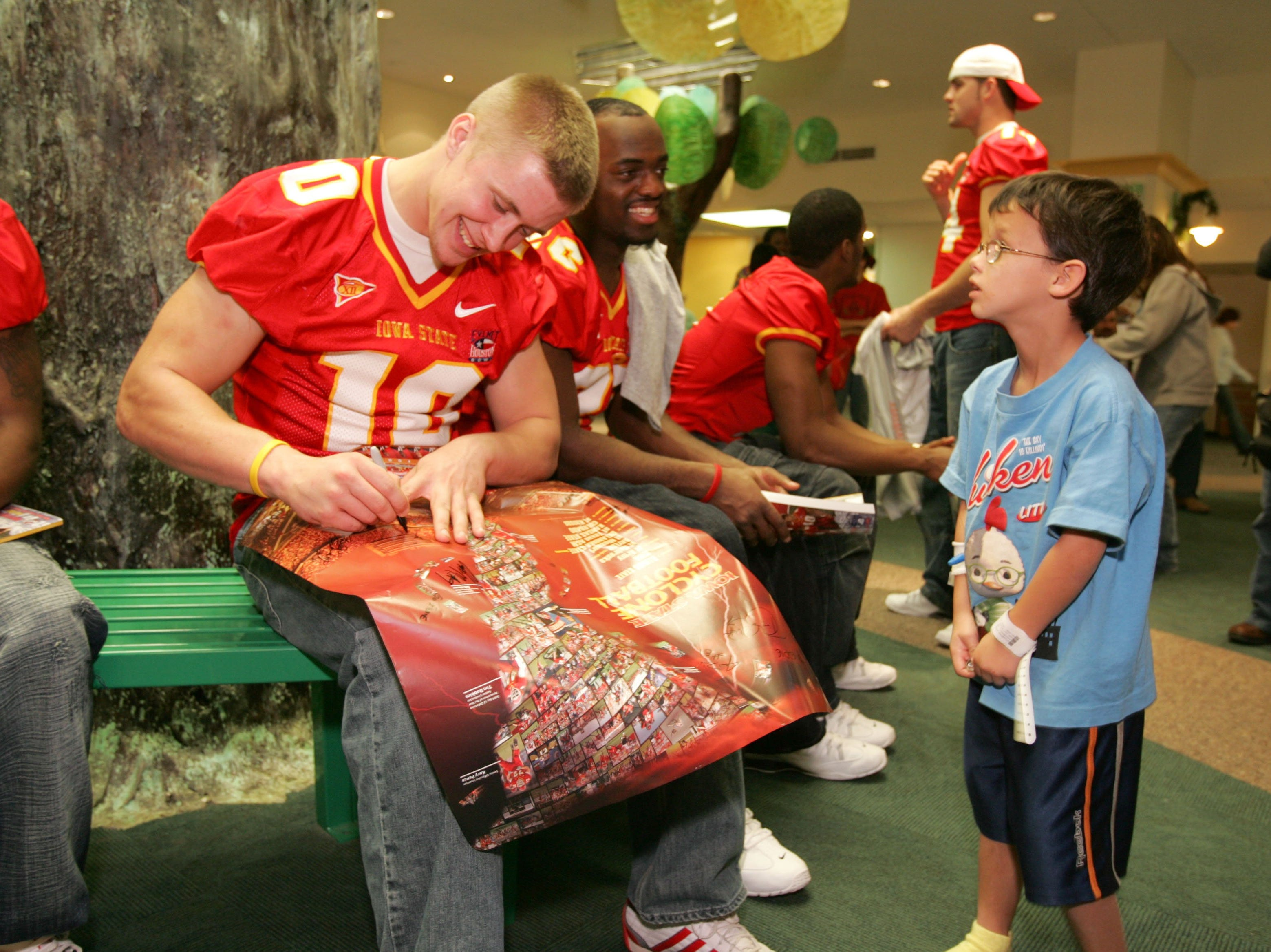 Cyclone player Kyle Van Winkle signs a poster at a children's hospital in Houston before the 2005 Houston Bowl.