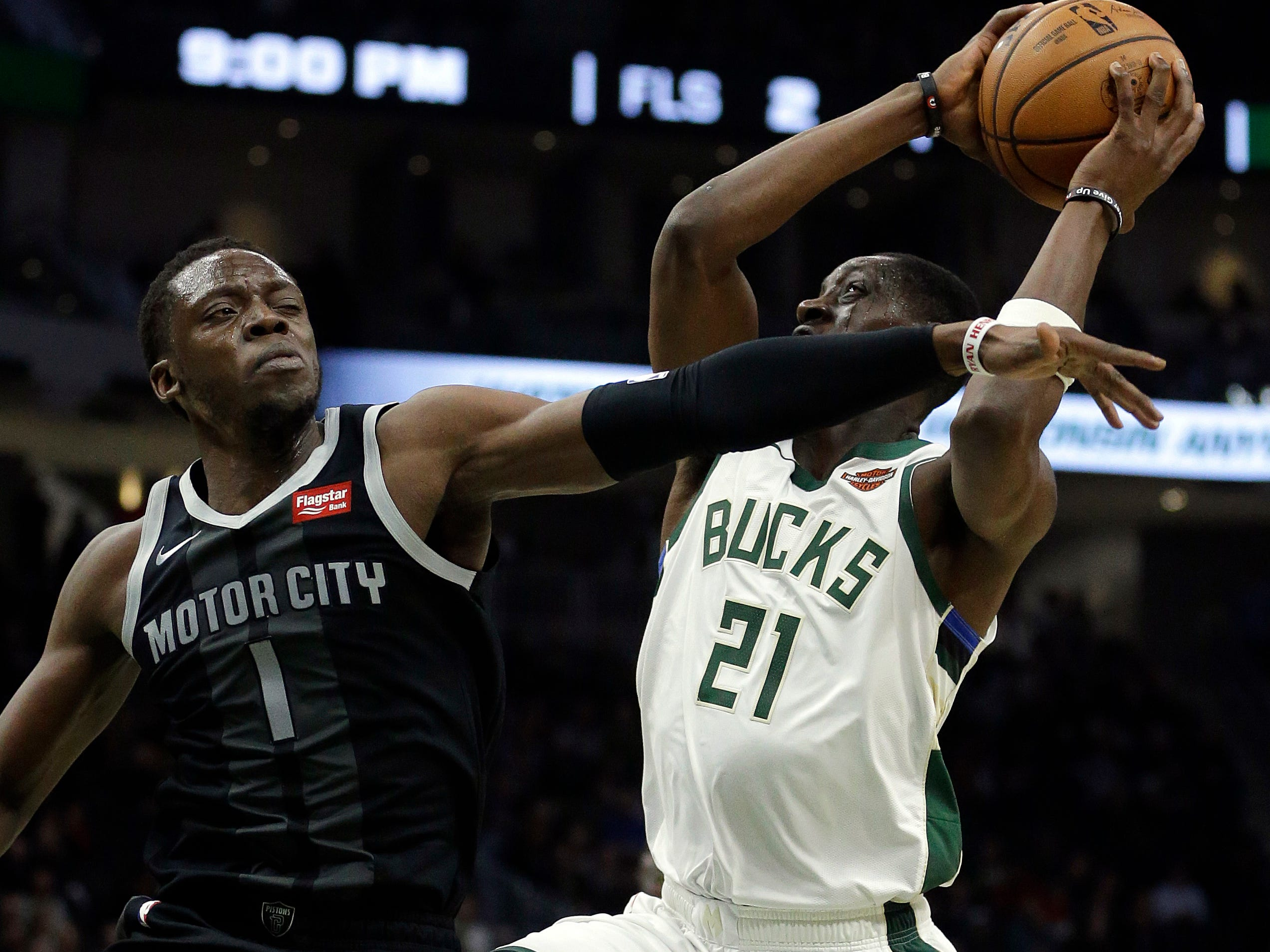 Milwaukee Bucks' Tony Snell is fouled by Detroit Pistons' Reggie Jackson during the second half Wednesday, Dec. 5, 2018, in Milwaukee.