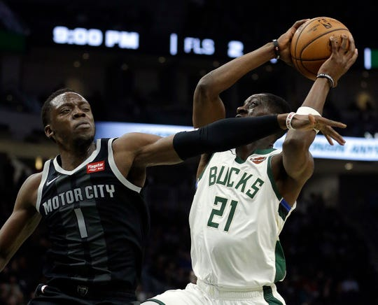 Milwaukee Bucks' Tony Snell is fouled by Detroit Pistons' Reggie Jackson during the second half Dec. 5, 2018, in Milwaukee.