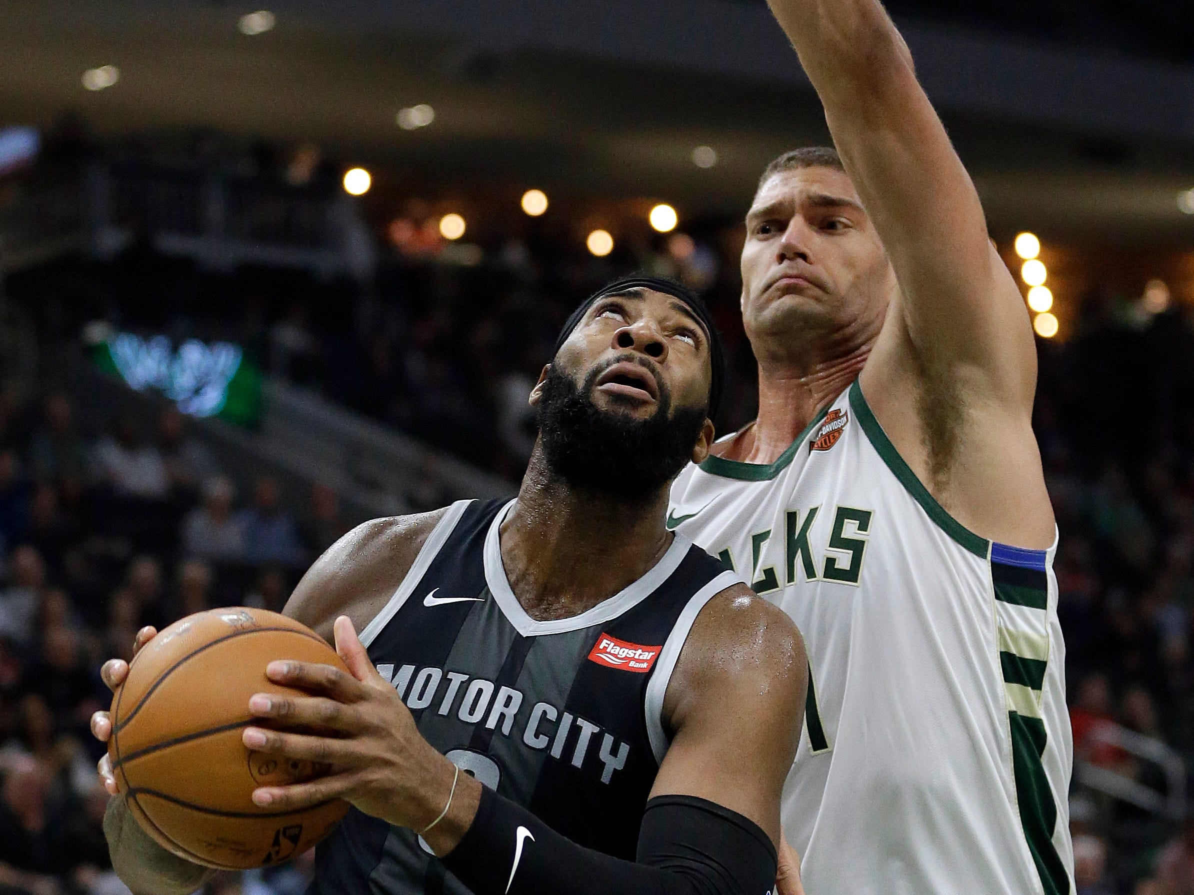 Detroit Pistons' Andre Drummond drives against Milwaukee Bucks' Brook Lopez during the first half Wednesday, Dec. 5, 2018, in Milwaukee.