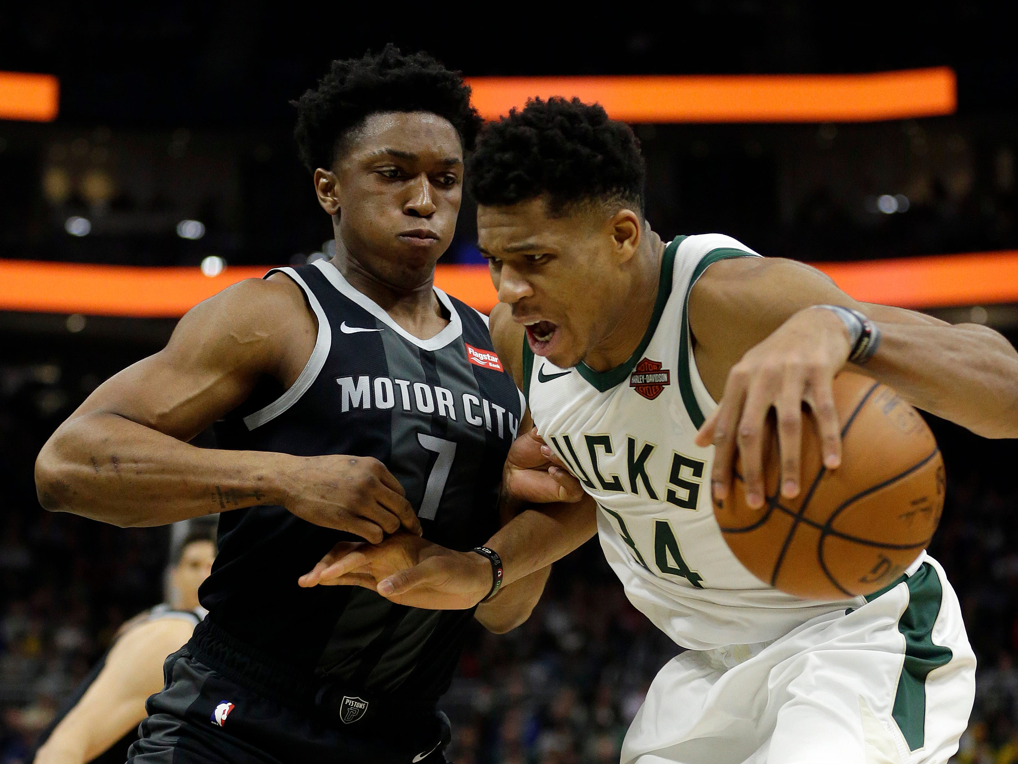 Milwaukee Bucks' Giannis Antetokounmpo drives against Detroit Pistons' Stanley Johnson during the second half Wednesday, Dec. 5, 2018, in Milwaukee.
