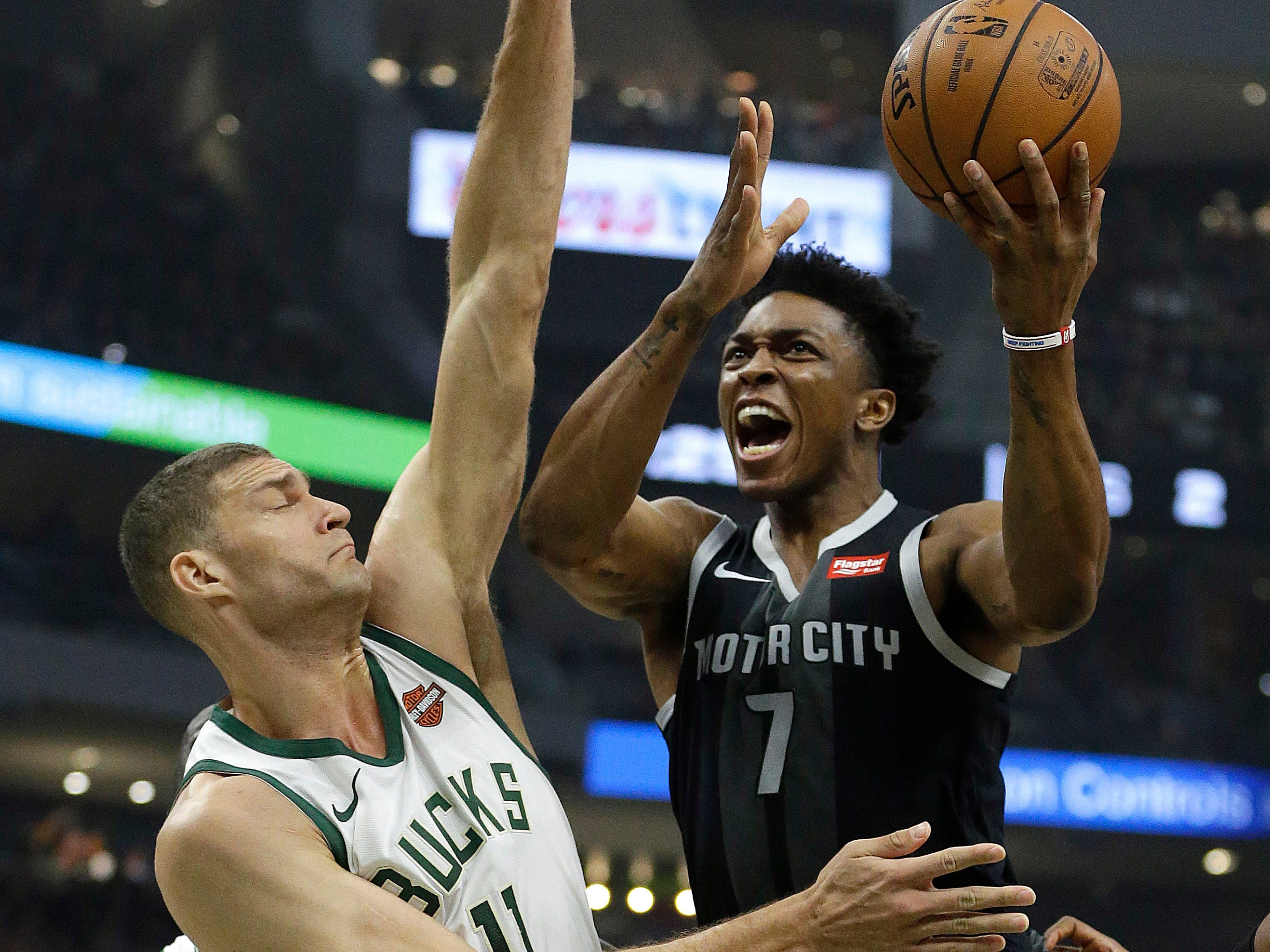 Detroit Pistons' Stanley Johnson goes up for a shot against Milwaukee Bucks' Brook Lopez during the first half Wednesday, Dec. 5, 2018, in Milwaukee.