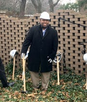 Amin Irving is president and CEO of Ginosko Development. He is about to swing a sledgehammer for the ceremonial teardown of a wall surrounding Shapero Hall in Lafayette Park in Detroit to build Lafayette West on Thursday, Dec. 6, 2018.