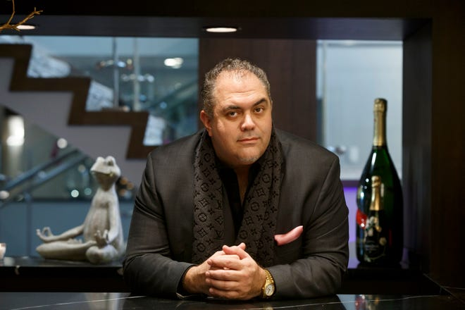 Zaid Elia, CEO and founder of The Elia Group poses for a photograph at a bar in the DoubleTree by Hilton Bloomfield Hills Detroit on Thursday, Dec. 6, 2018 in Bloomfield Hills.