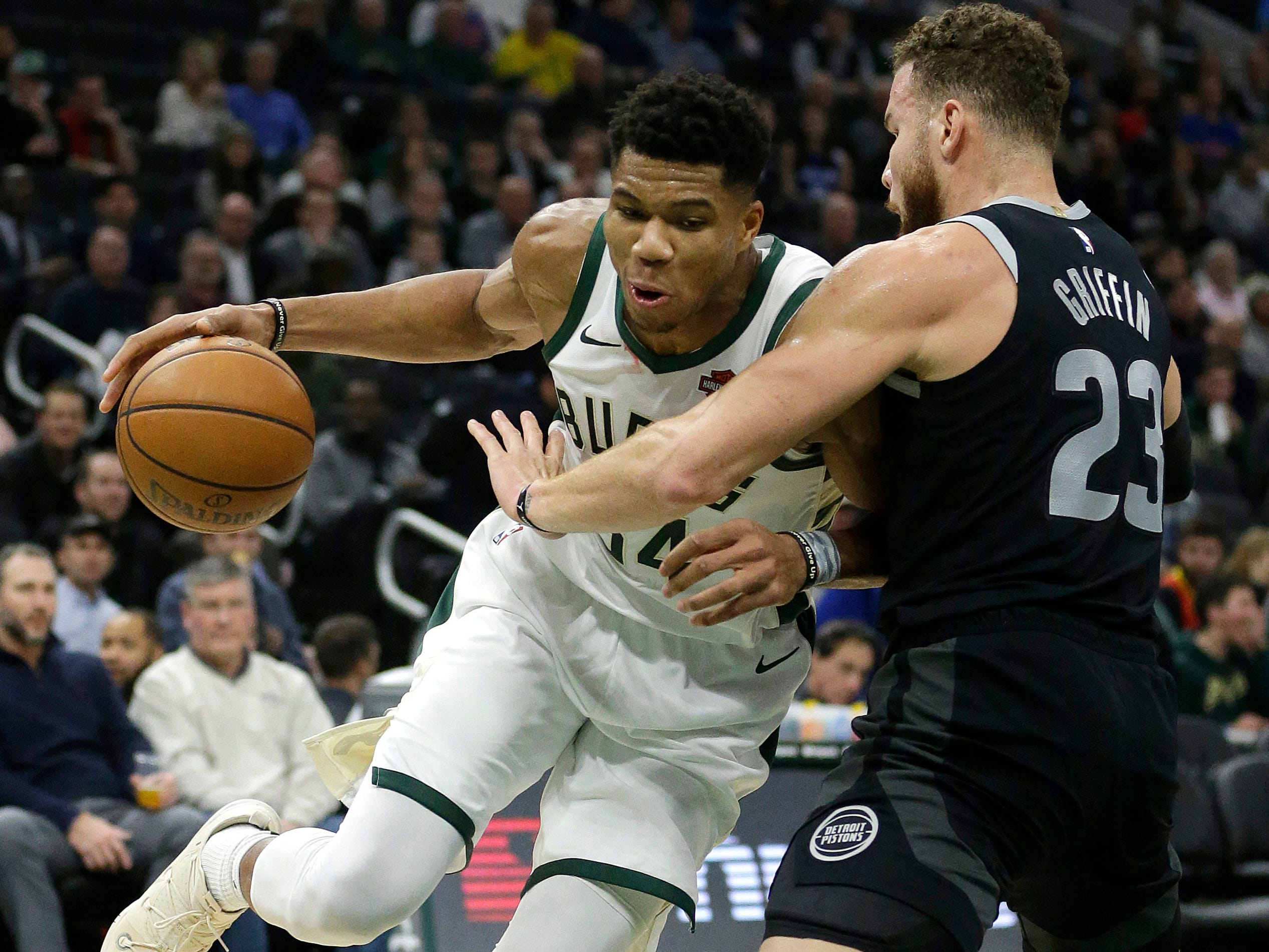 Milwaukee's Giannis Antetokounmpo, left, drives against Detroit's Blake Griffin during the second half.