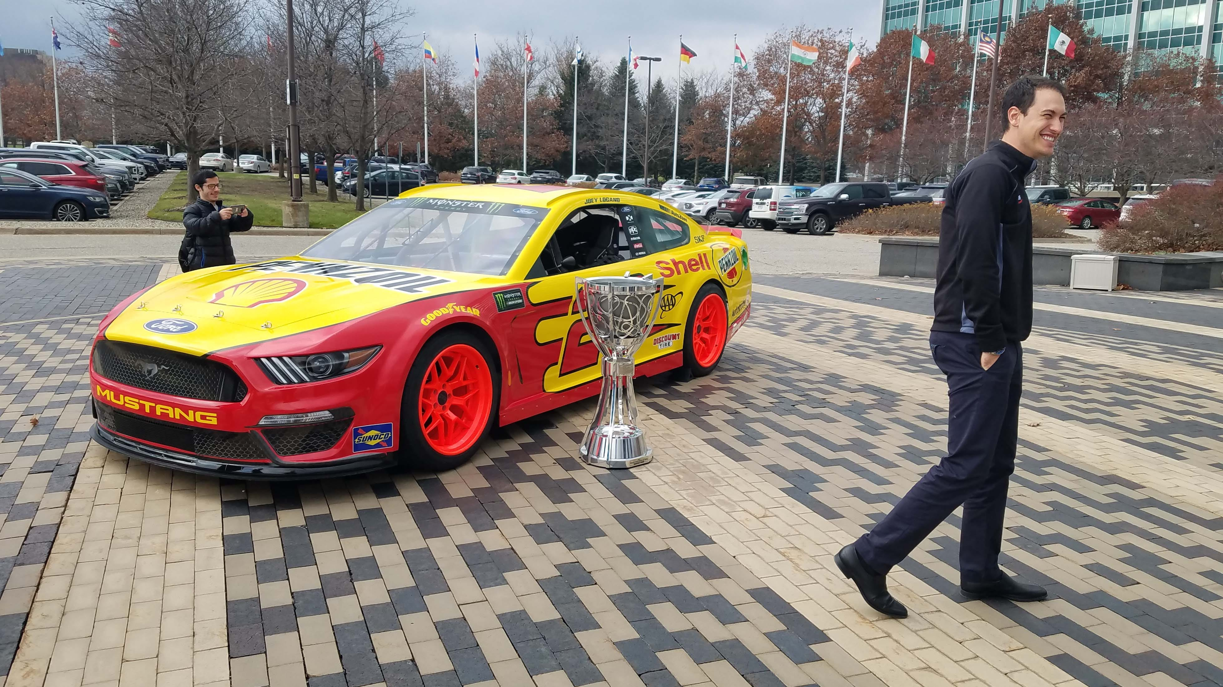 NASCAR champ Joey Logano enjoys his victory gift - a NASCAR Ford Mustang drifter - in front of Ford HQ.