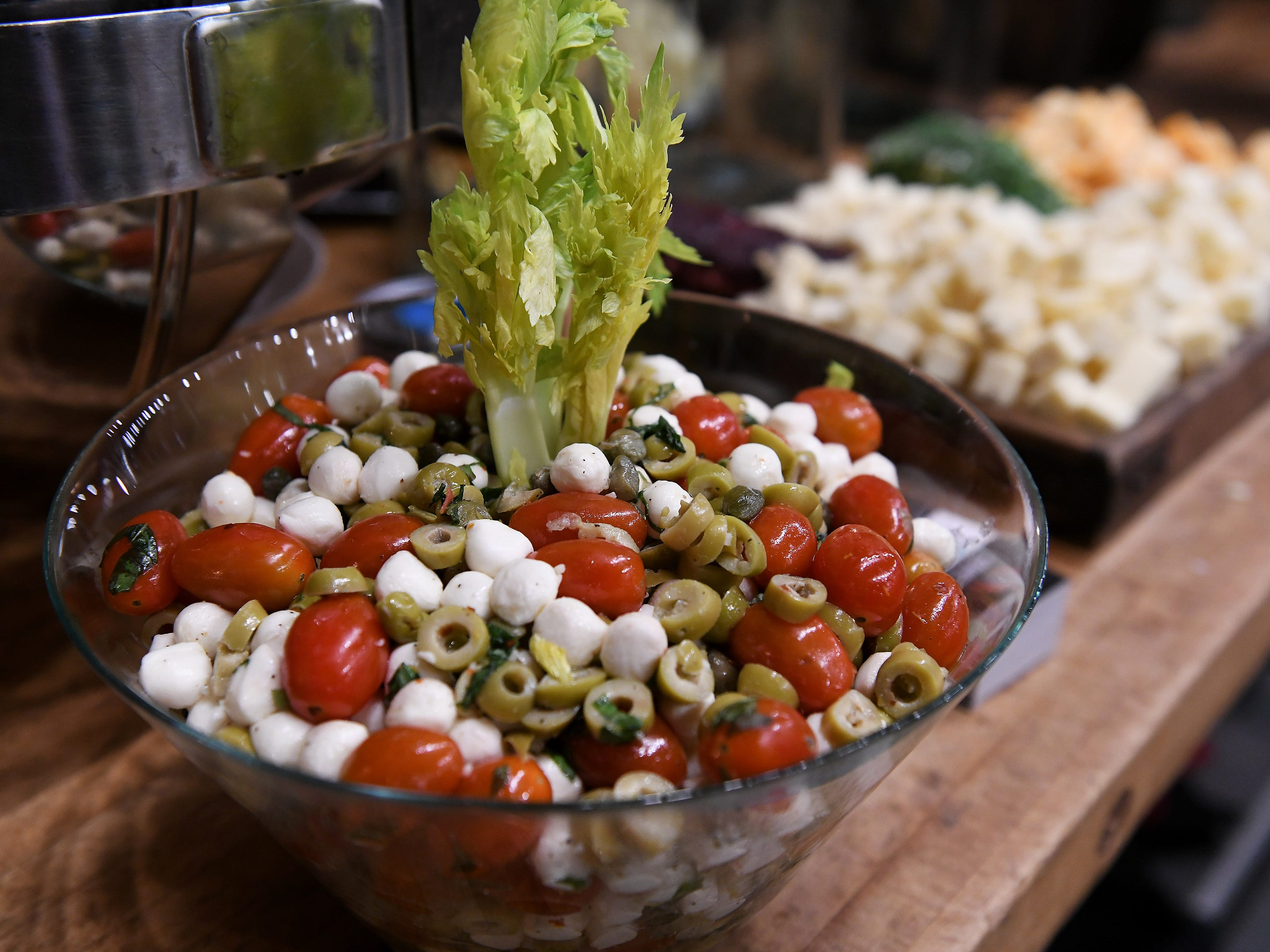 Cherry tomatoes, mozzarella and olives are part of the appetizers provided by Craft Creative Catering.