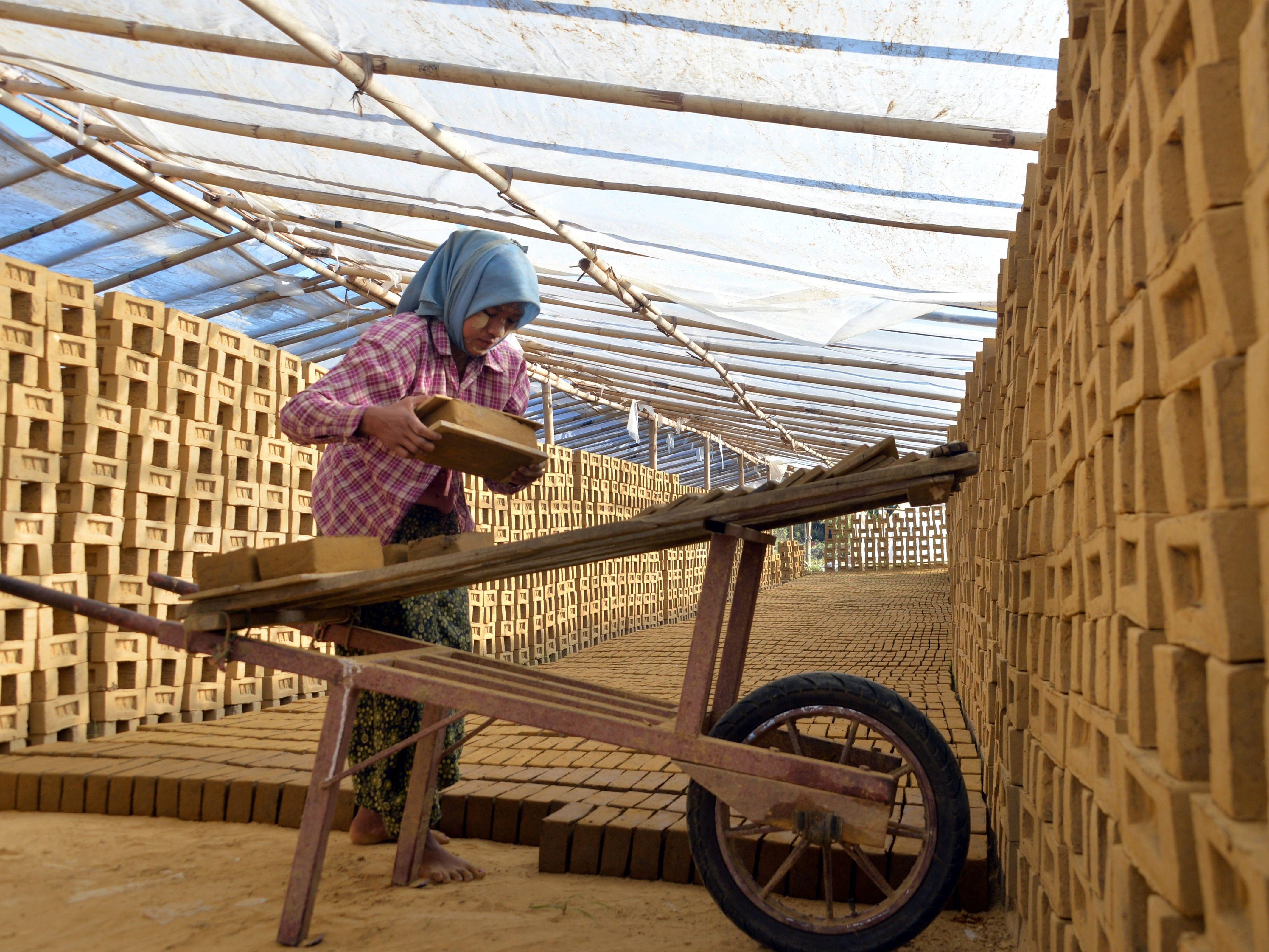 A Myanmar woman works in a brick factory in Naypyidaw, Dec. 5, 2018.